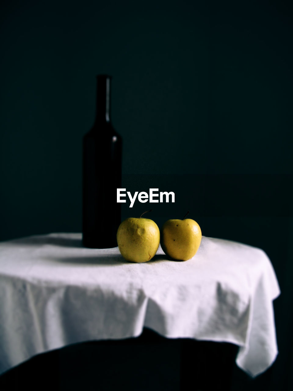 food and drink, still life, no people, indoors, studio shot, fruit, food, black background, bottle, close-up, freshness, container, yellow, table, healthy eating, copy space, refreshment, alcohol, drink, wellbeing
