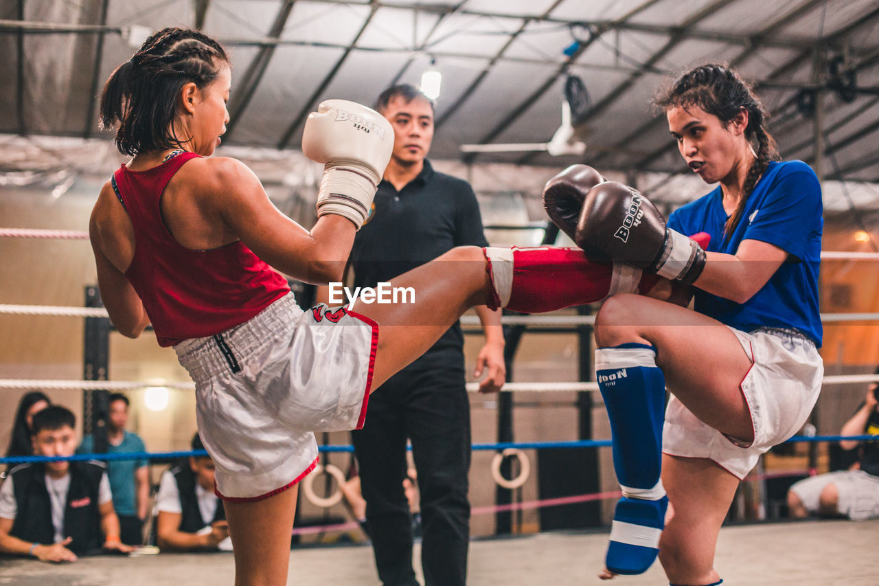 sport, group of people, men, real people, focus on foreground, lifestyles, indoors, adult, people, boxing - sport, competition, women, young men, young adult, three quarter length, leisure activity, togetherness, athlete, healthy lifestyle