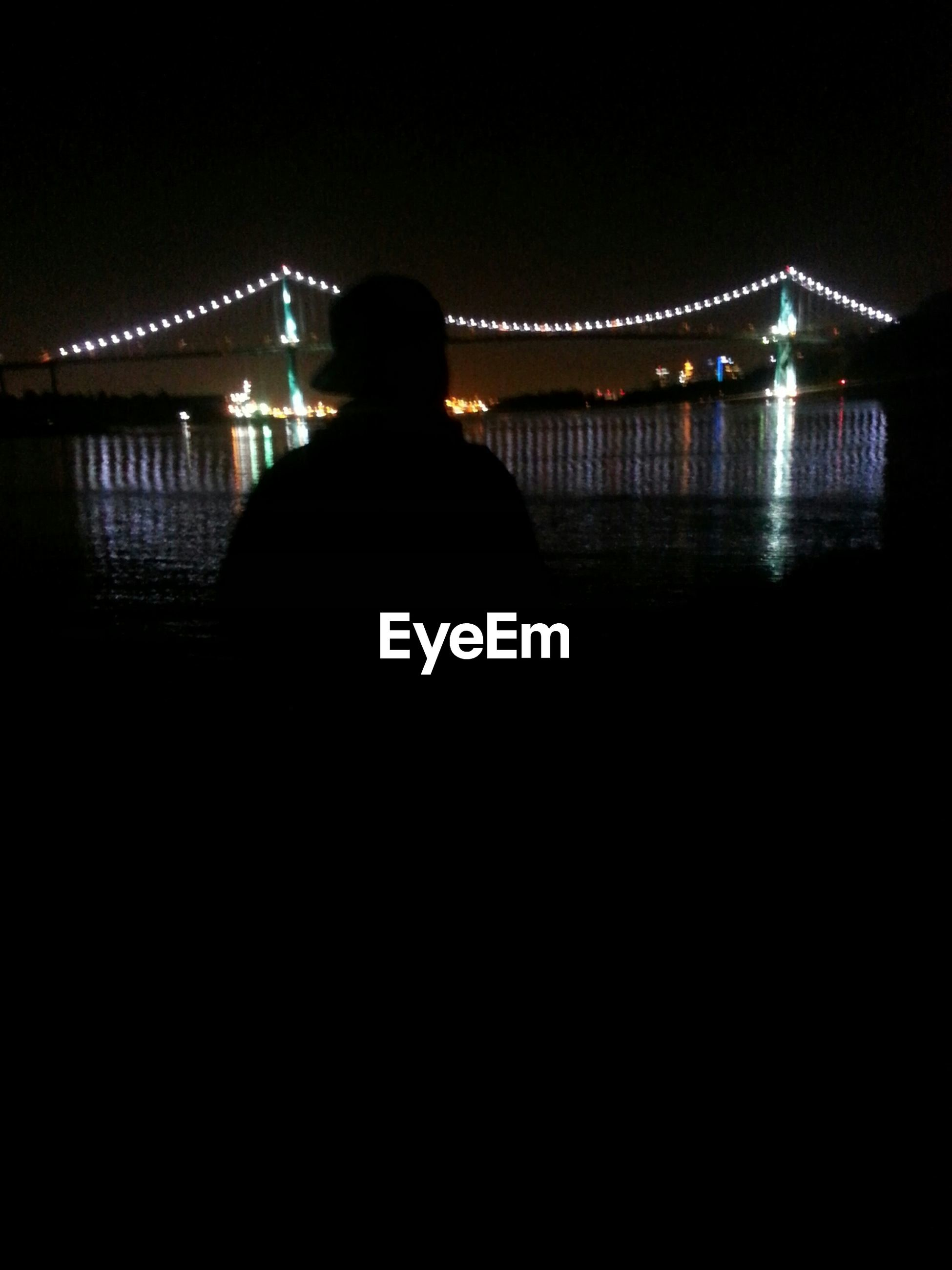 night, illuminated, silhouette, built structure, architecture, bridge - man made structure, connection, dark, bridge, river, copy space, water, rear view, railing, men, reflection, standing, city