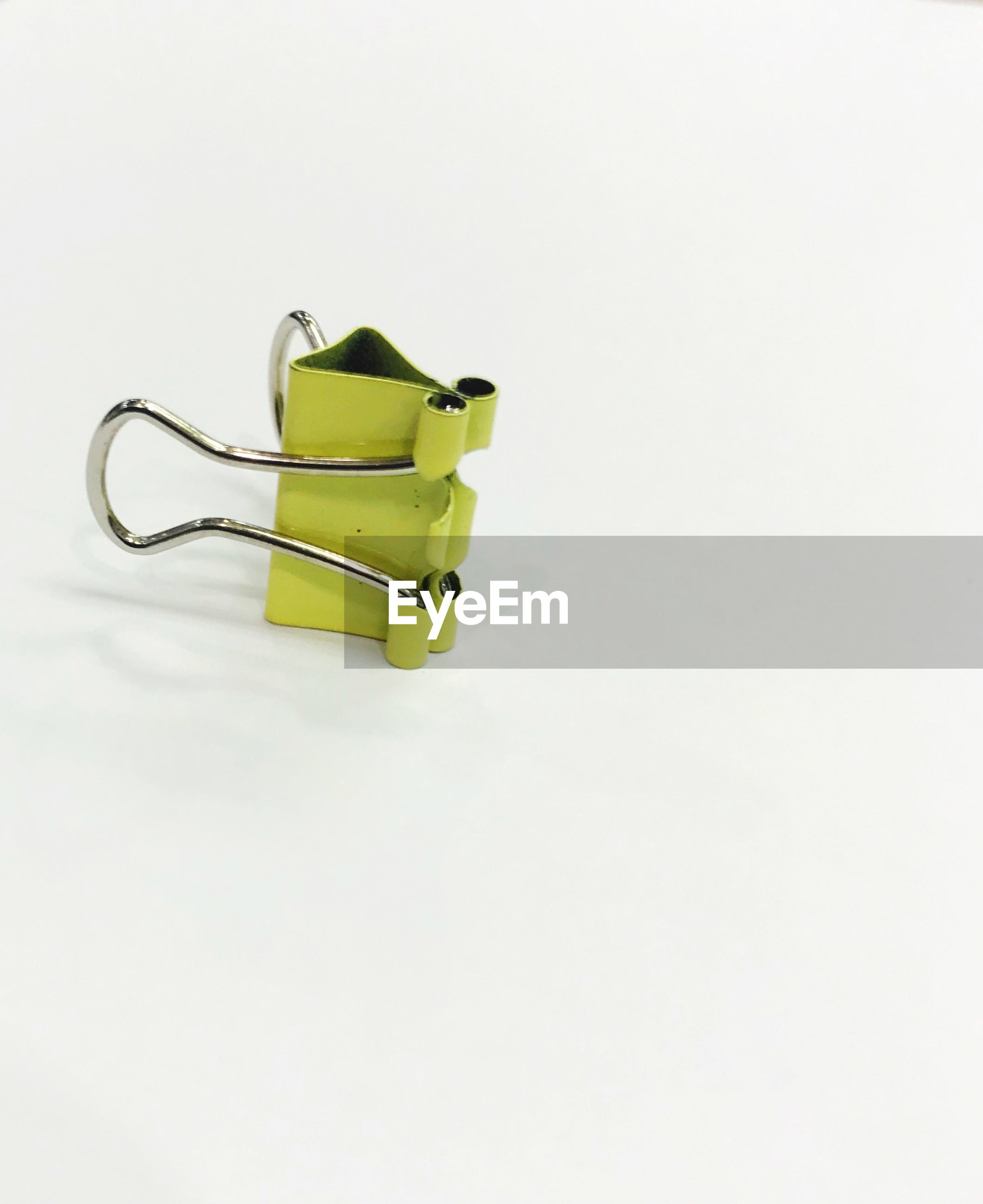 HIGH ANGLE VIEW OF TOY ON WHITE BACKGROUND