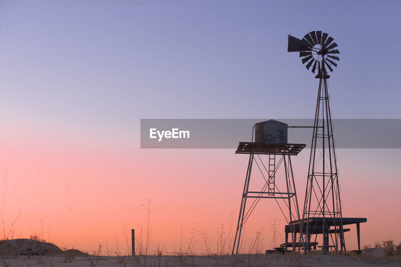 WINDMILL AGAINST SKY DURING SUNSET