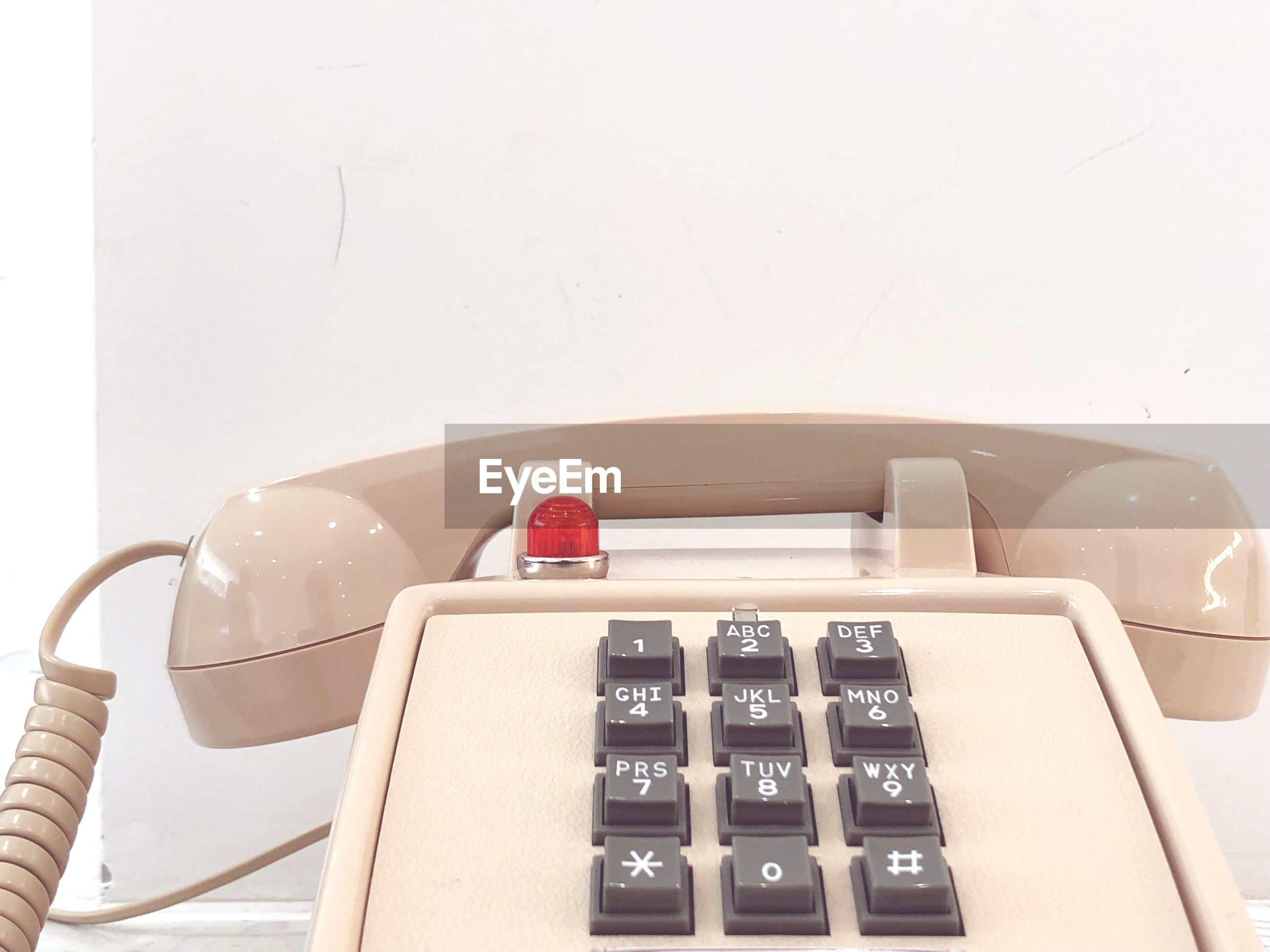 HIGH ANGLE VIEW OF TELEPHONE BOOTH ON TABLE