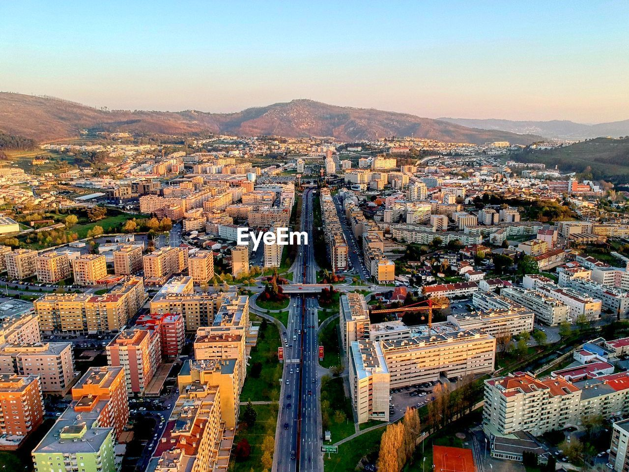 architecture, city, built structure, building exterior, cityscape, sky, crowded, crowd, building, high angle view, residential district, aerial view, nature, mountain, travel destinations, day, outdoors, clear sky, office building exterior, skyscraper, townscape