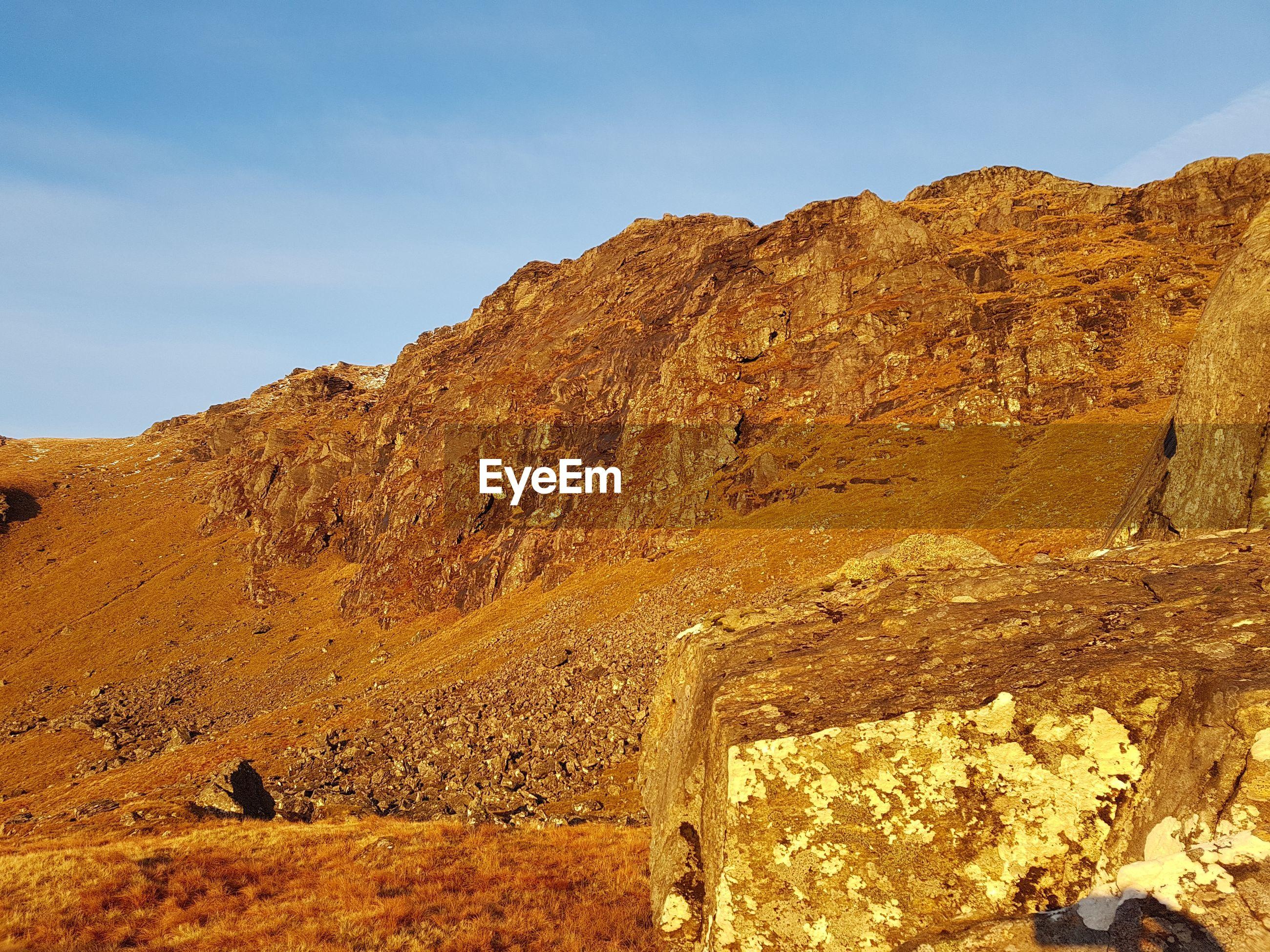 Ben dorain, bridge of orchy, golden sunset  on rocks