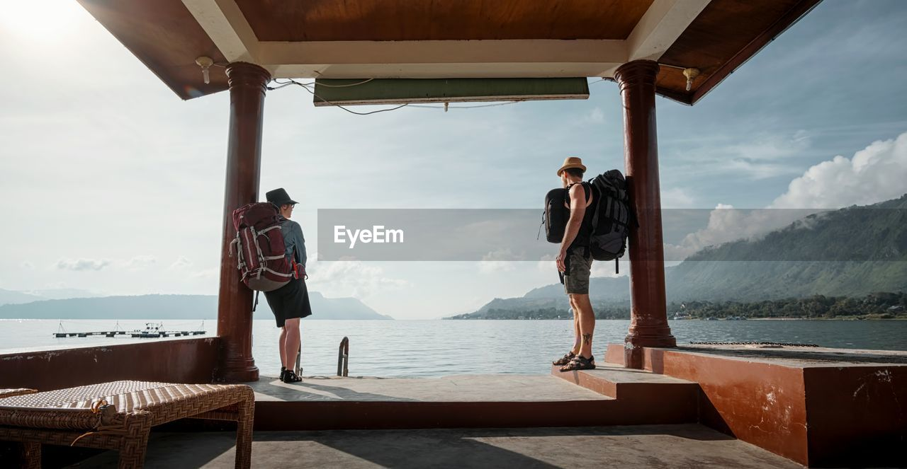 real people, sea, sky, water, men, standing, nature, beauty in nature, full length, lifestyles, day, leisure activity, scenics - nature, architecture, adult, casual clothing, young adult, people, cloud - sky, outdoors