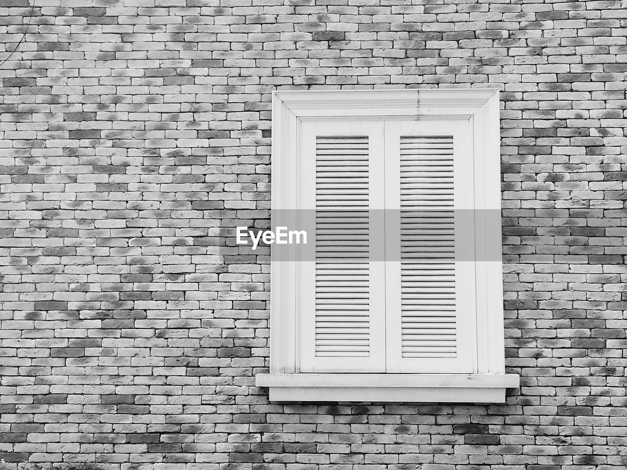 built structure, architecture, window, brick wall, brick, building exterior, wall, wall - building feature, no people, day, building, pattern, closed, outdoors, house, white color, shape, security, geometric shape, full frame, window frame, exhaust fan