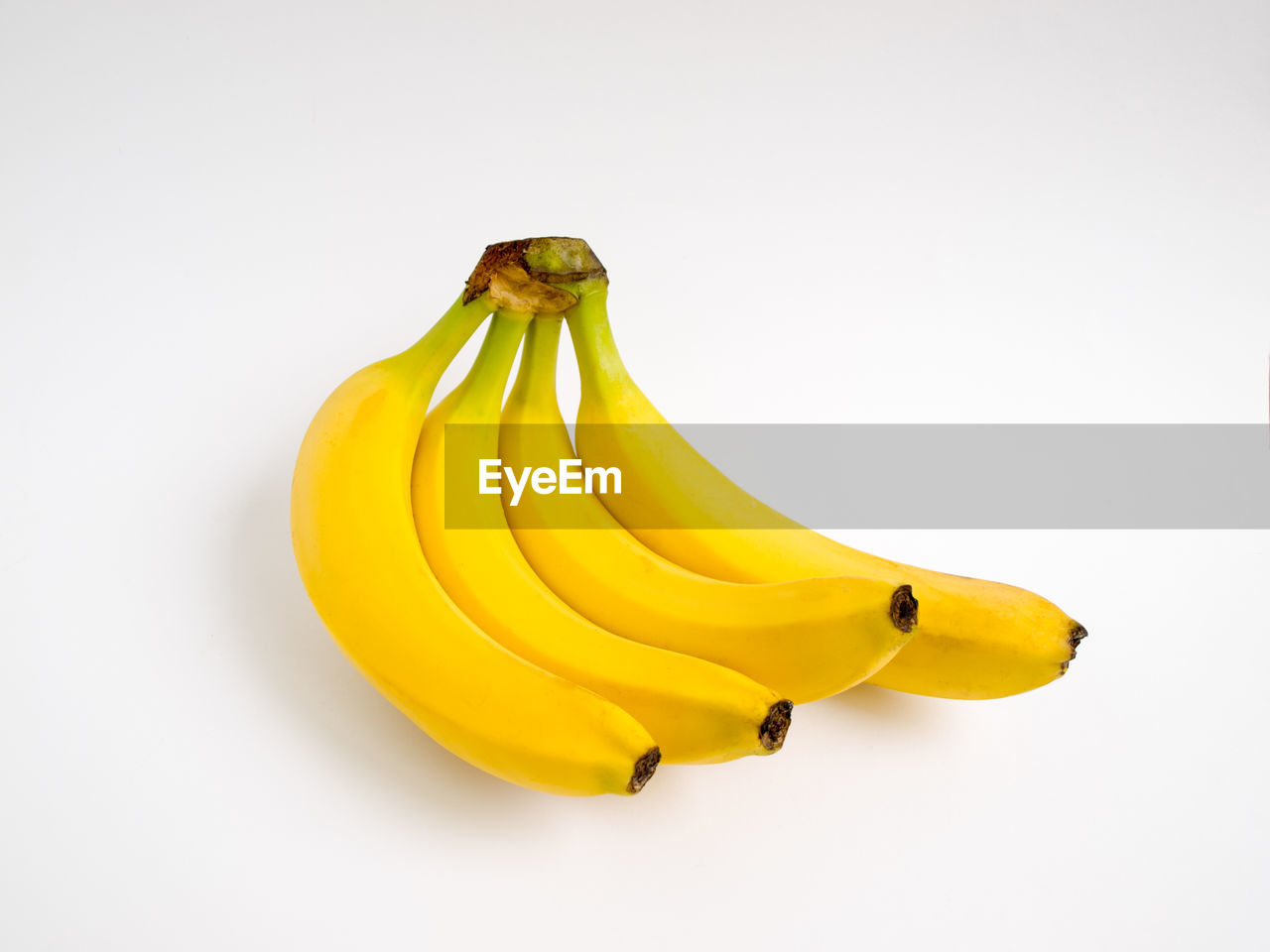 yellow, studio shot, white background, banana, healthy eating, wellbeing, food and drink, freshness, food, fruit, still life, copy space, indoors, close-up, no people, ripe, cut out, group of objects, bunch, single object, snack