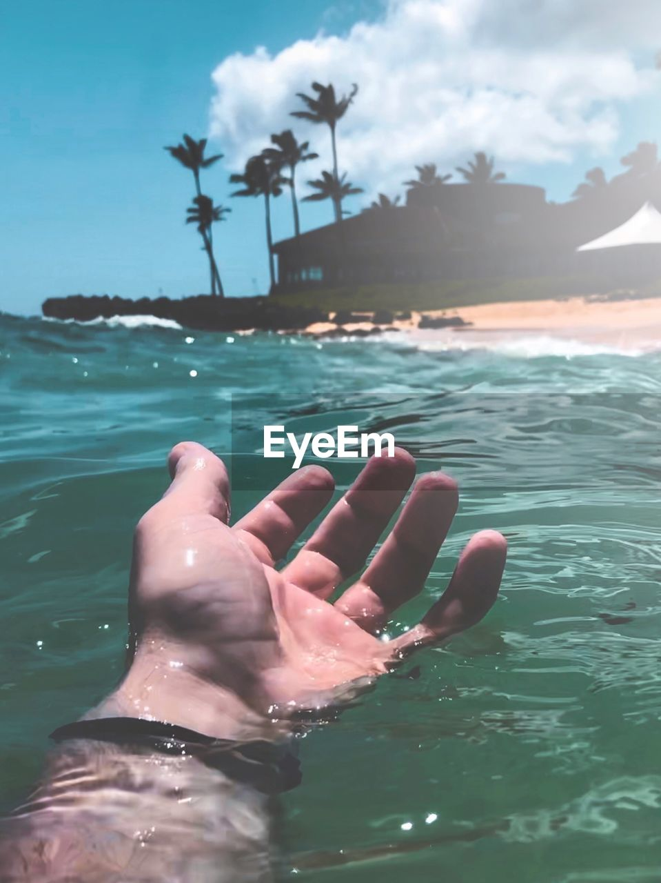 water, human body part, sea, one person, real people, human hand, body part, hand, nature, lifestyles, leisure activity, personal perspective, finger, human finger, sky, day, close-up, adult, outdoors, human foot, nail, human limb