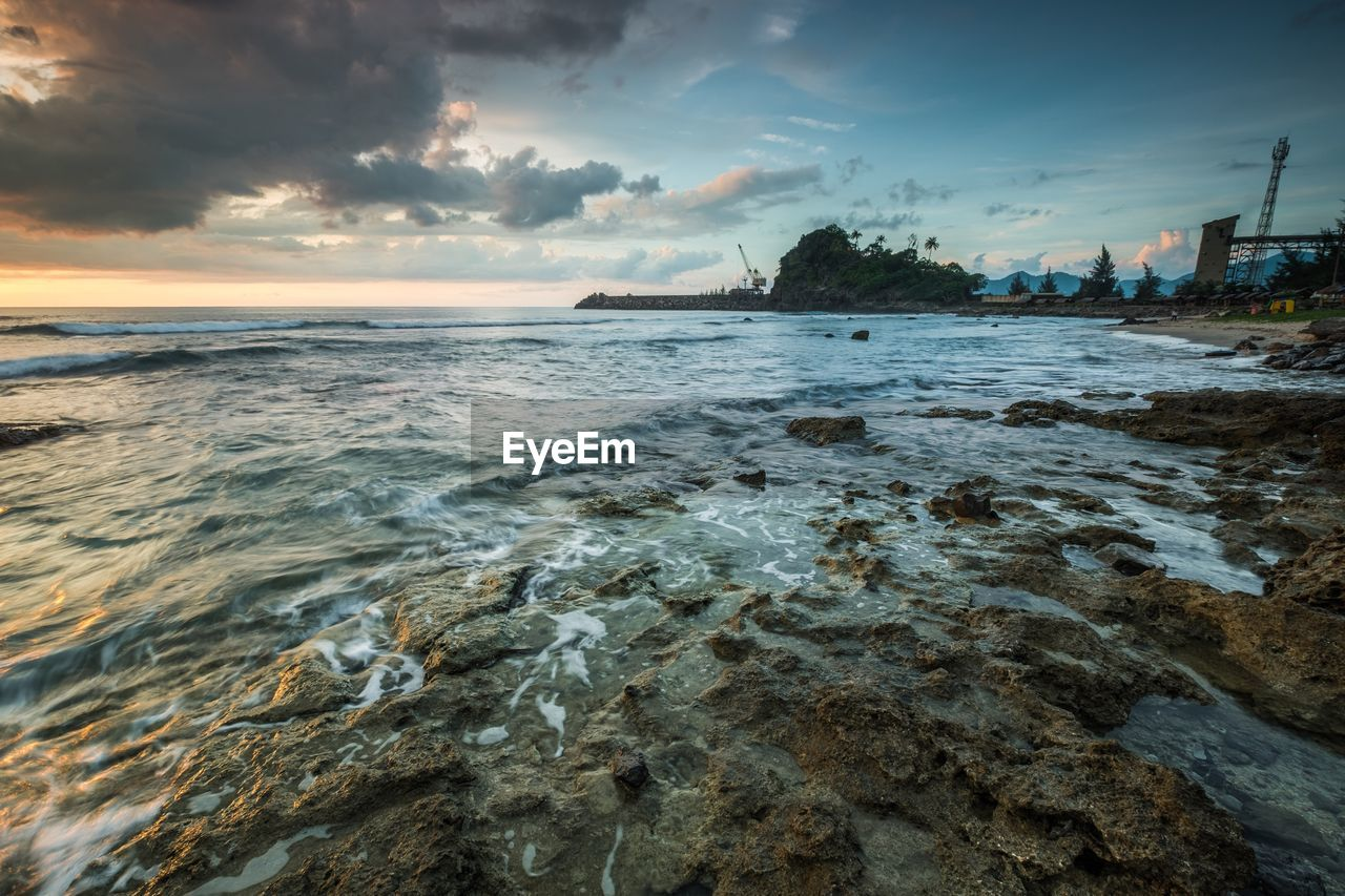 sea, sky, nature, water, cloud - sky, beauty in nature, tranquility, scenics, tranquil scene, no people, sunset, outdoors, beach, horizon over water, travel destinations, wave, tree, day