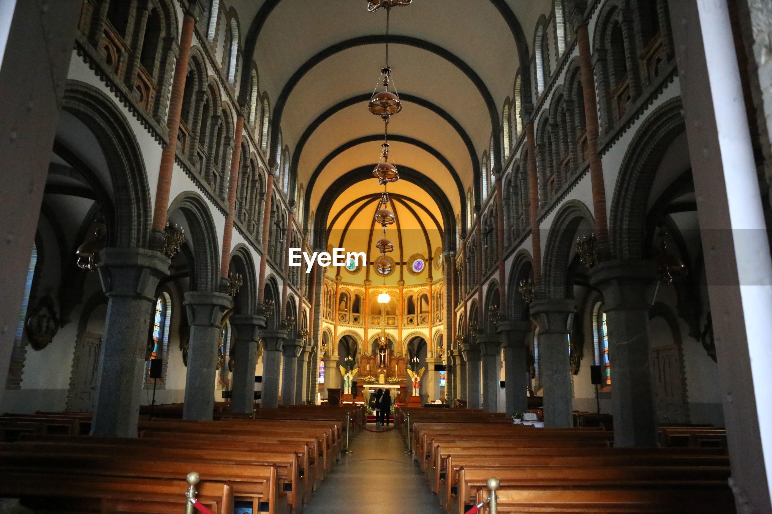 Pews in illuminated church