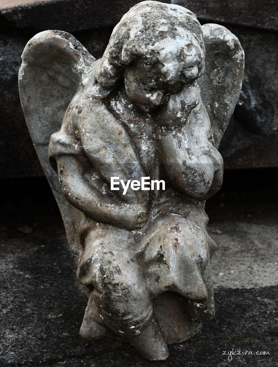 statue, sculpture, art and craft, human representation, no people, close-up, spirituality, day, outdoors, gargoyle