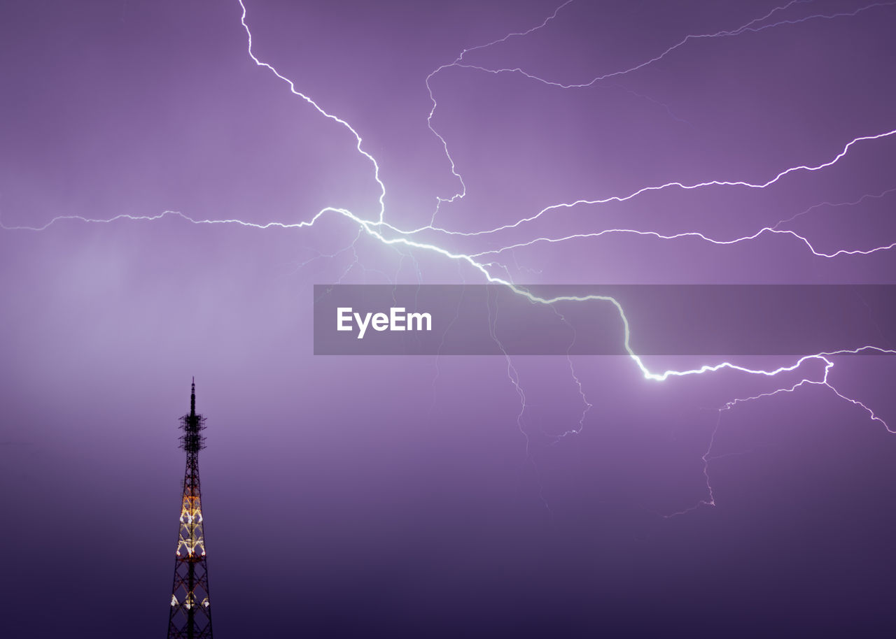 lightning, power in nature, storm, power, night, thunderstorm, cloud - sky, beauty in nature, sky, forked lightning, illuminated, communication, dramatic sky, architecture, no people, warning sign, built structure, nature, building exterior, outdoors, purple, electricity