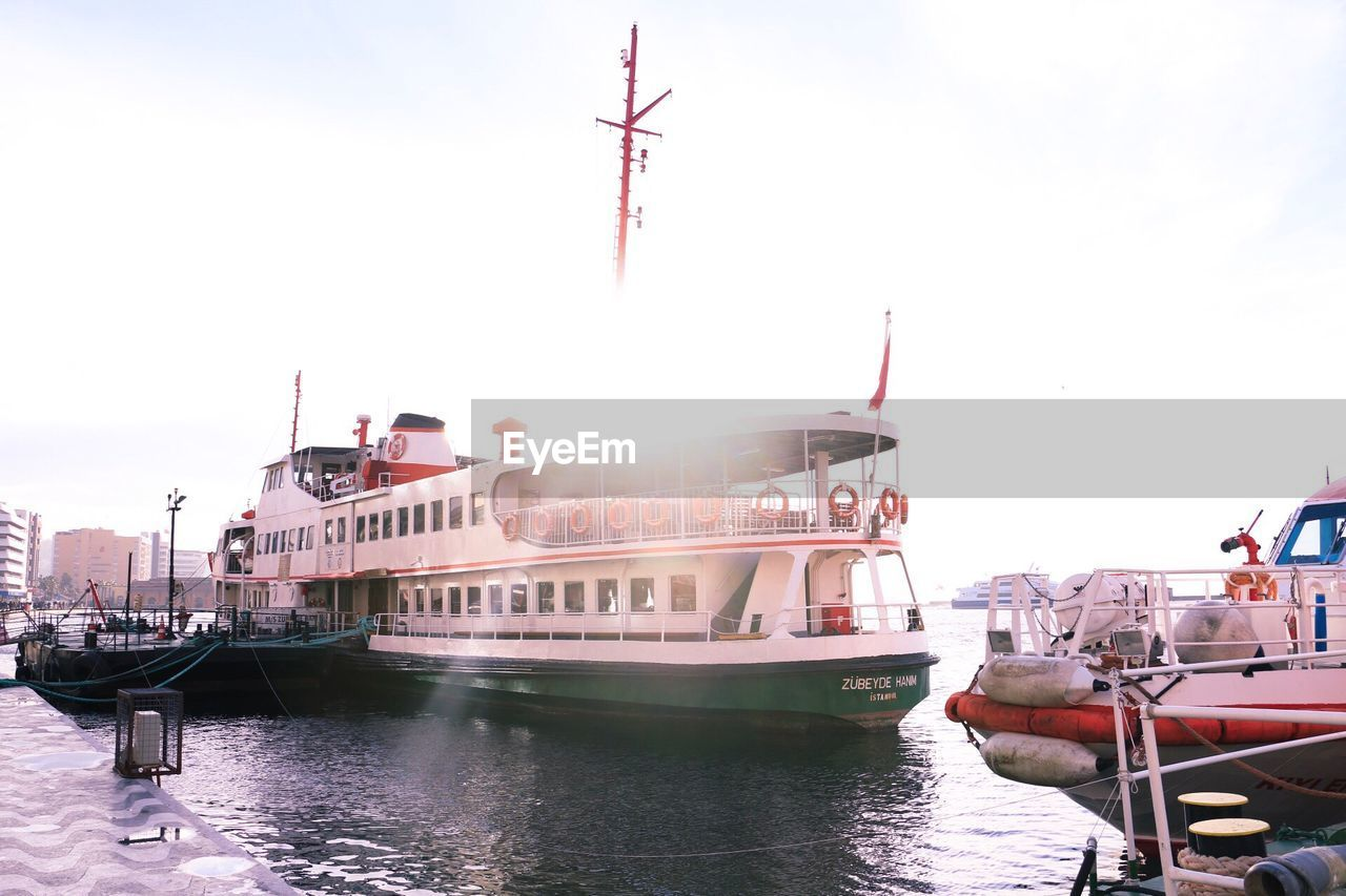 nautical vessel, transportation, mode of transport, boat, moored, day, sky, travel, travel destinations, water, waterfront, outdoors, built structure, harbor, clear sky, building exterior, nature, no people, yacht, architecture, sailing, mast