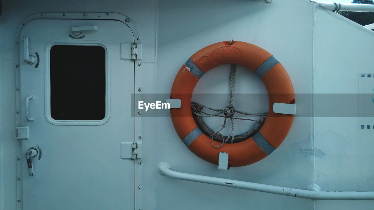Close-up of life belt hanging in boat