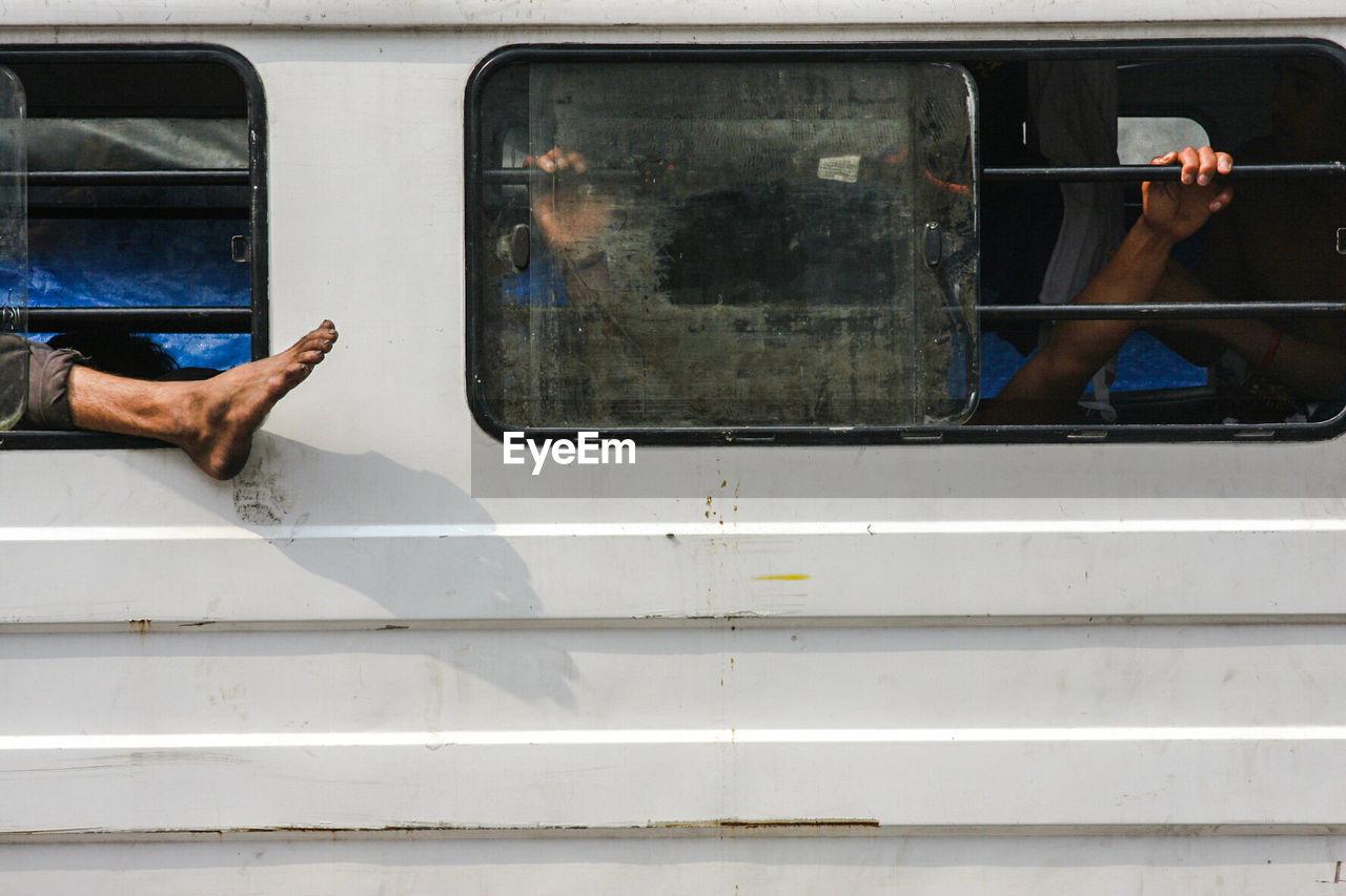 View Of Passengers Through Bus Window