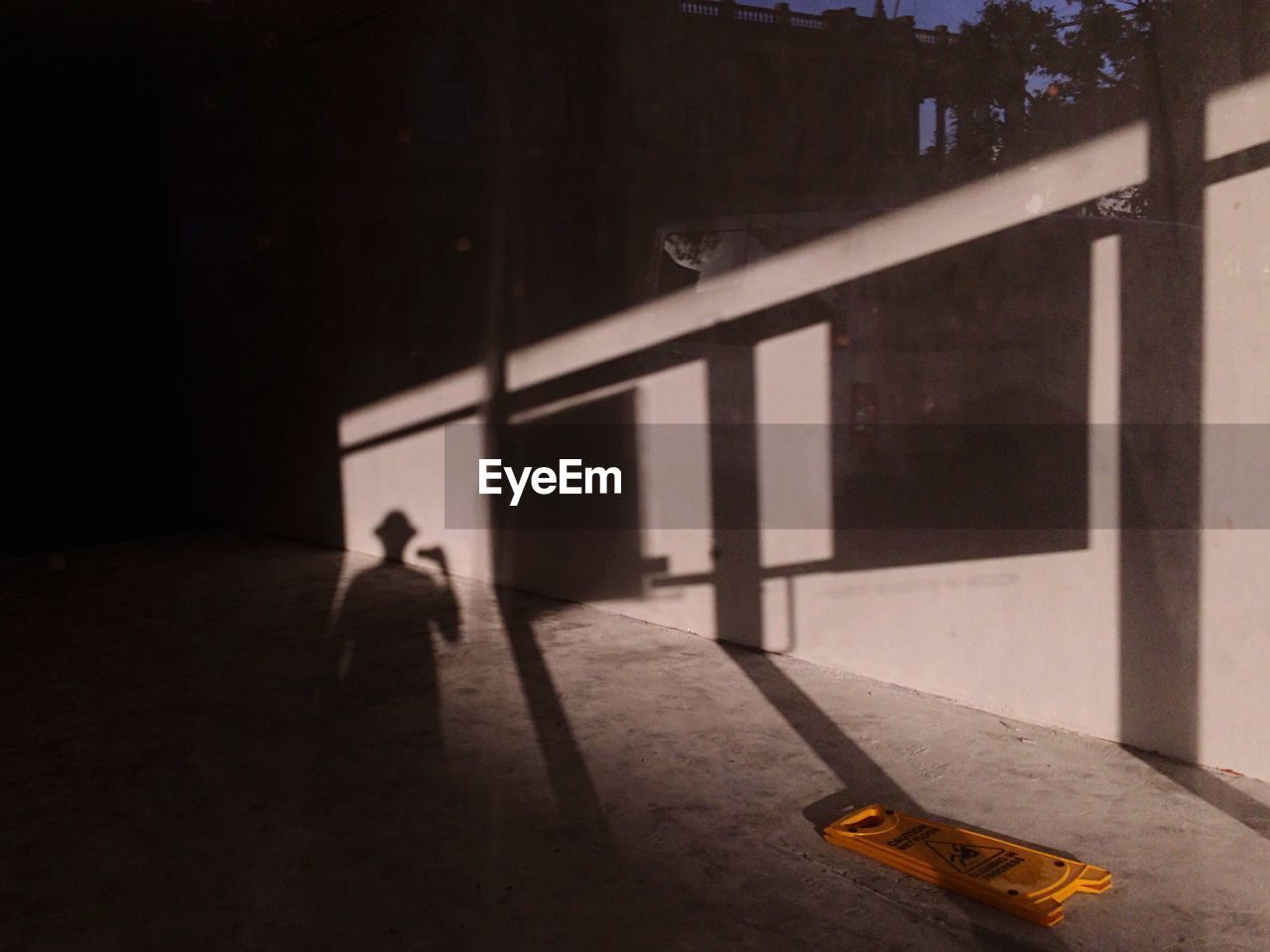 Focus On Shadow Of Man On Wall