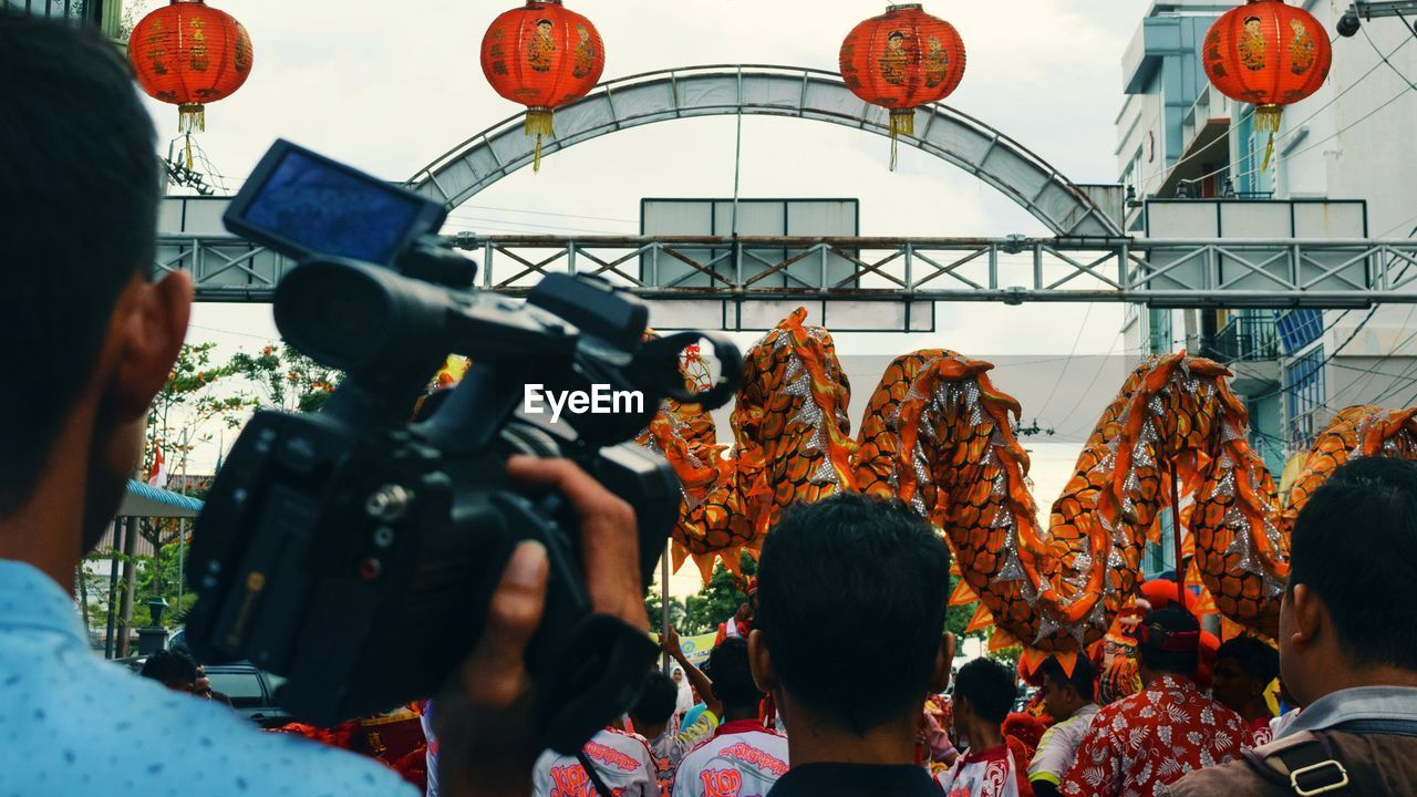 People Celebrating Chinese New Year On Street In City