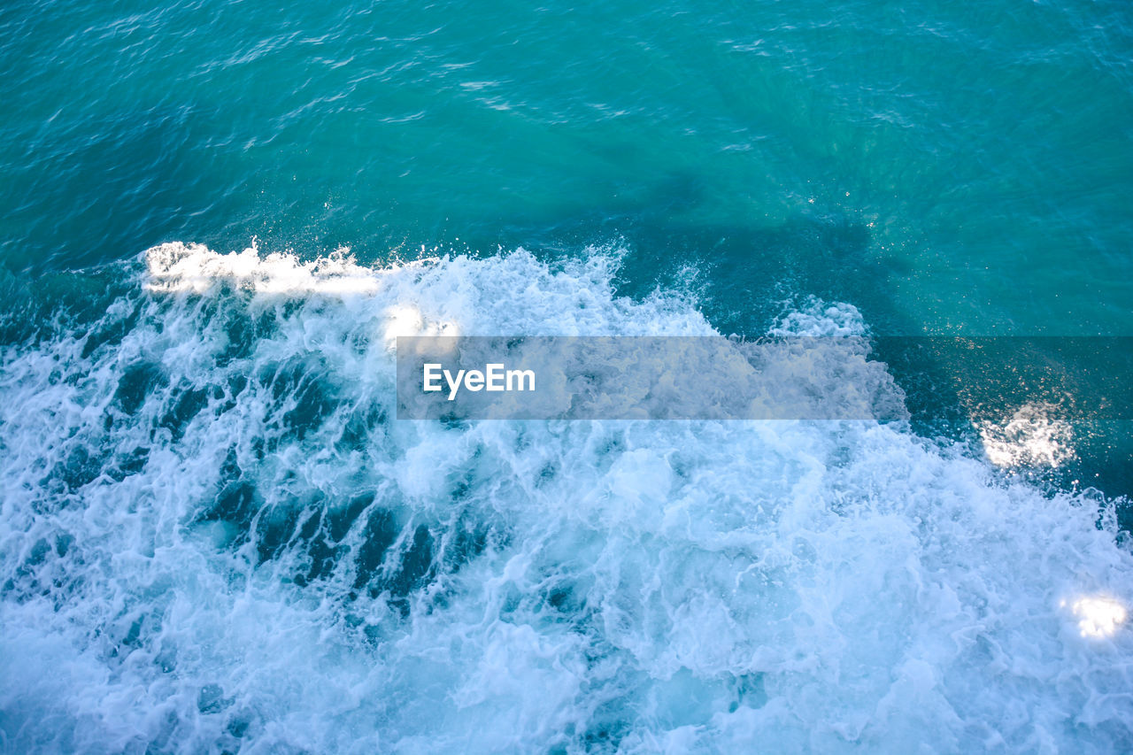 sea, water, sport, motion, aquatic sport, wave, beauty in nature, surfing, blue, nature, high angle view, day, splashing, waterfront, scenics - nature, power, outdoors, power in nature, turquoise colored, breaking