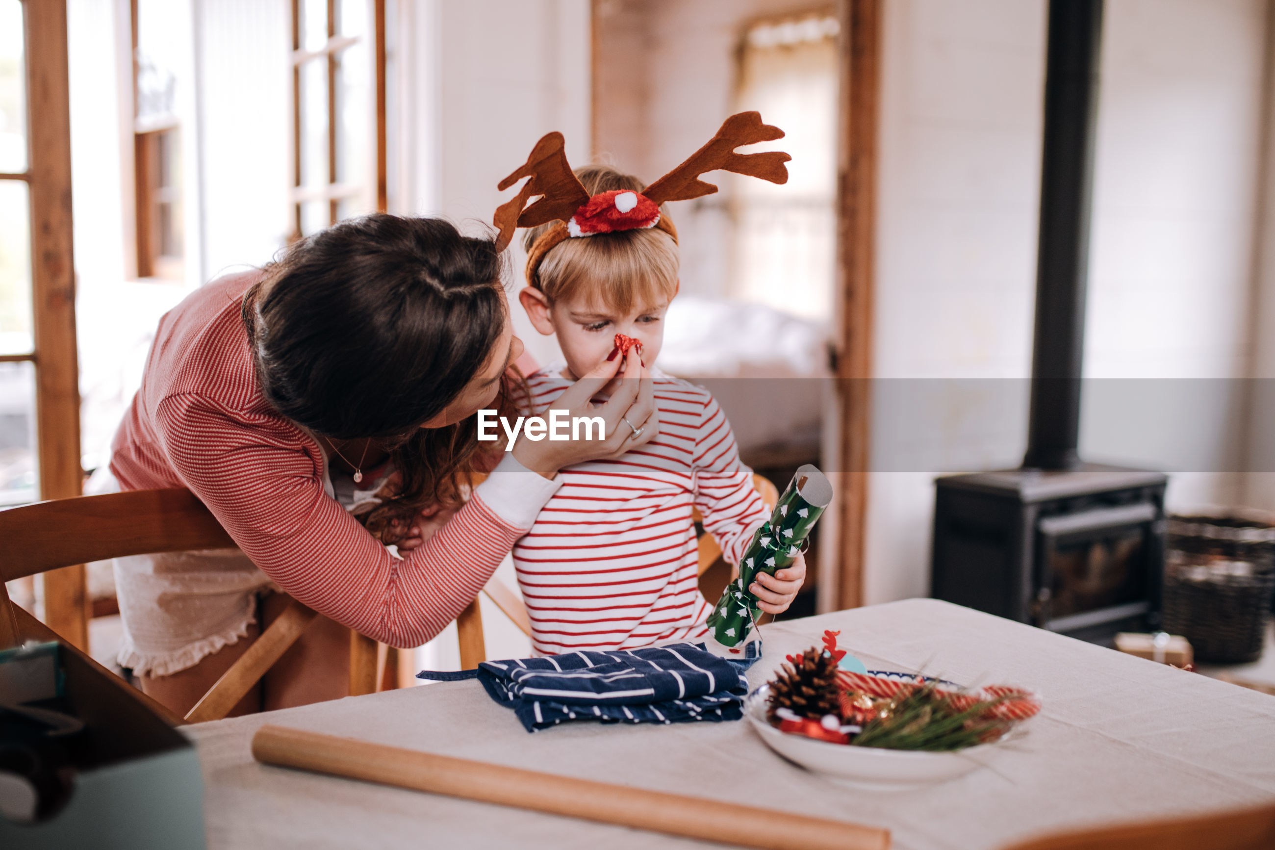 Mother enjoying with cute son during christmas