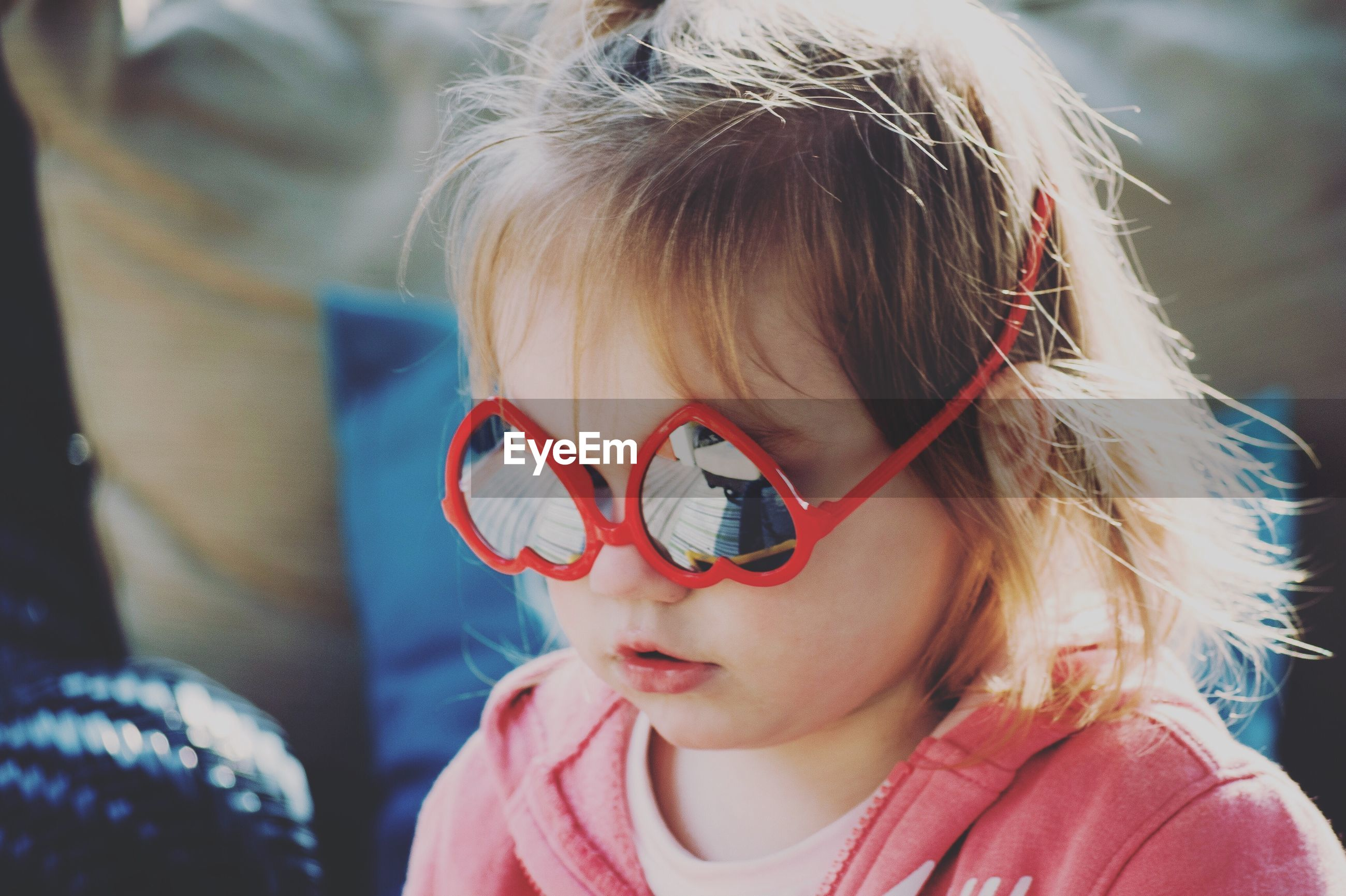 child, childhood, real people, headshot, one person, portrait, focus on foreground, blond hair, hair, leisure activity, lifestyles, innocence, close-up, cute, front view, glasses, women, day, fashion, outdoors, hairstyle