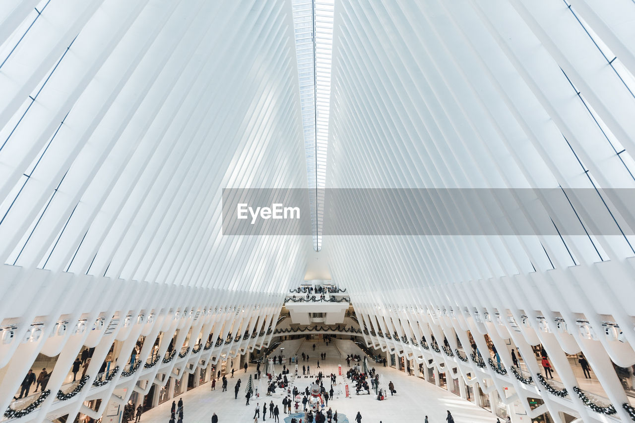 built structure, architecture, building exterior, group of people, real people, building, city, day, low angle view, modern, large group of people, travel, incidental people, tourism, crowd, tall - high, travel destinations, office building exterior, lifestyles, architectural feature, ceiling, skyscraper