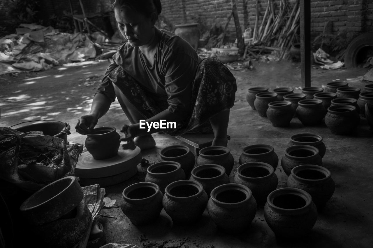 Female Potter Making Pots