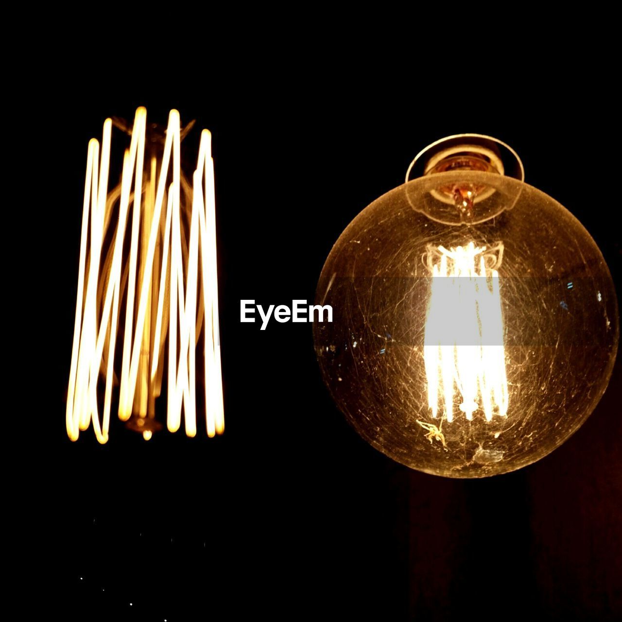 Close-Up Of Illuminated Light Bulb Against In Darkroom