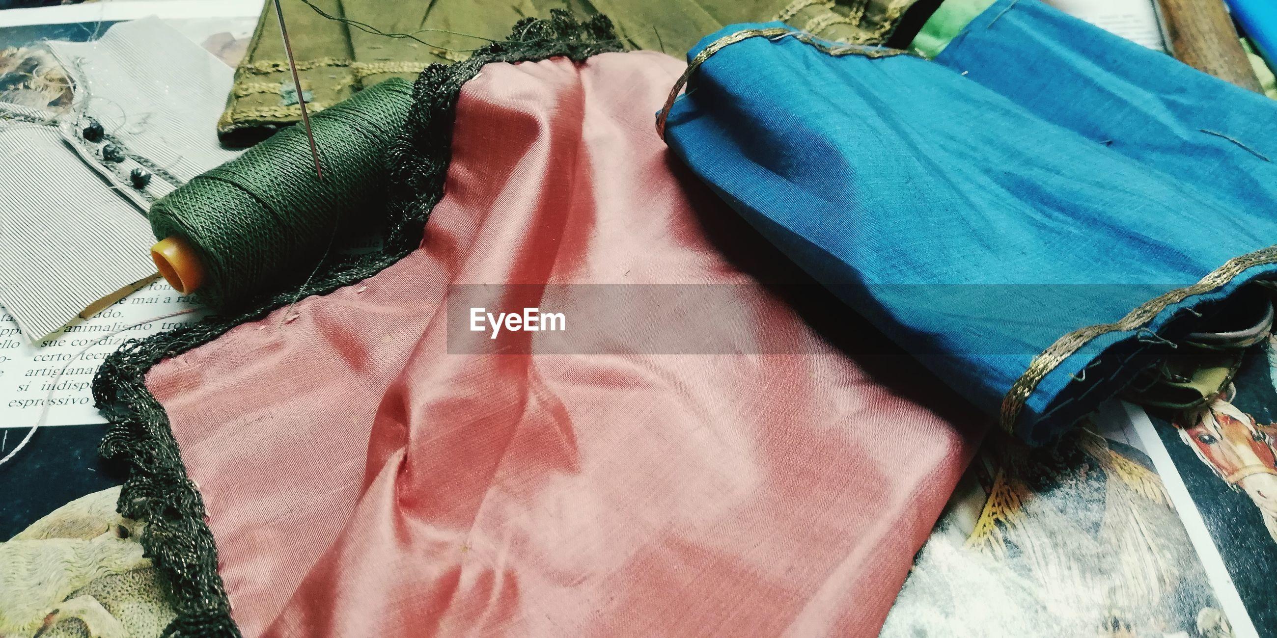High angle view of fabrics on table