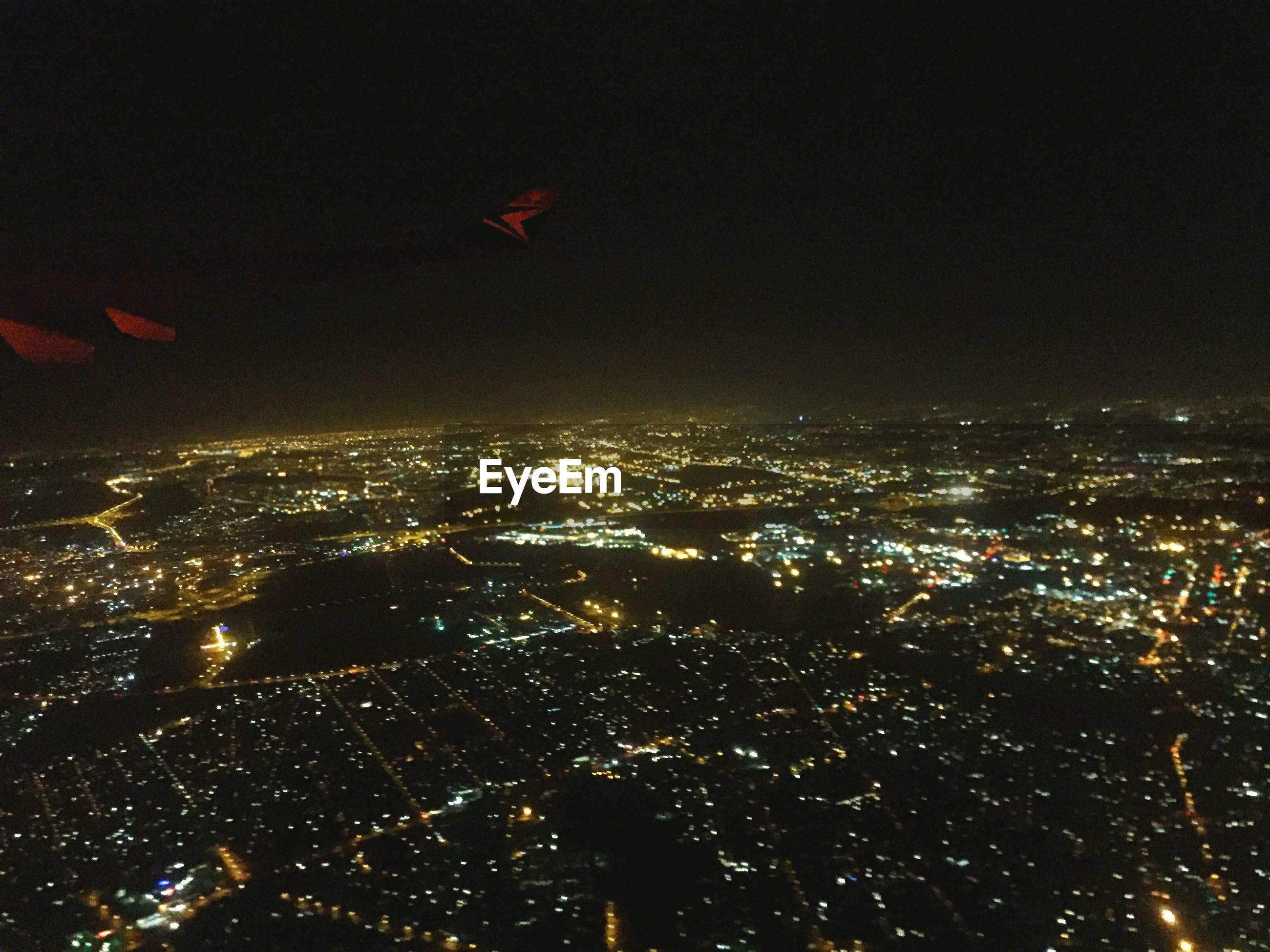illuminated, night, cityscape, city, aerial view, architecture, building exterior, crowded, built structure, high angle view, copy space, residential district, city life, sky, skyscraper, dark, clear sky, modern, no people, capital cities