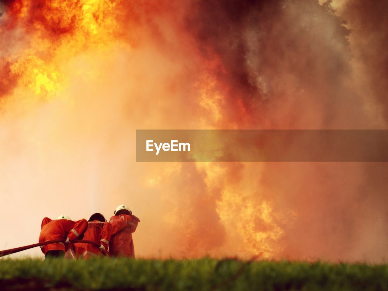 burning, fire, fire - natural phenomenon, grass, flame, nature, plant, land, field, heat - temperature, smoke - physical structure, orange color, accidents and disasters, environment, outdoors, one person, sign, warning sign, day, pollution
