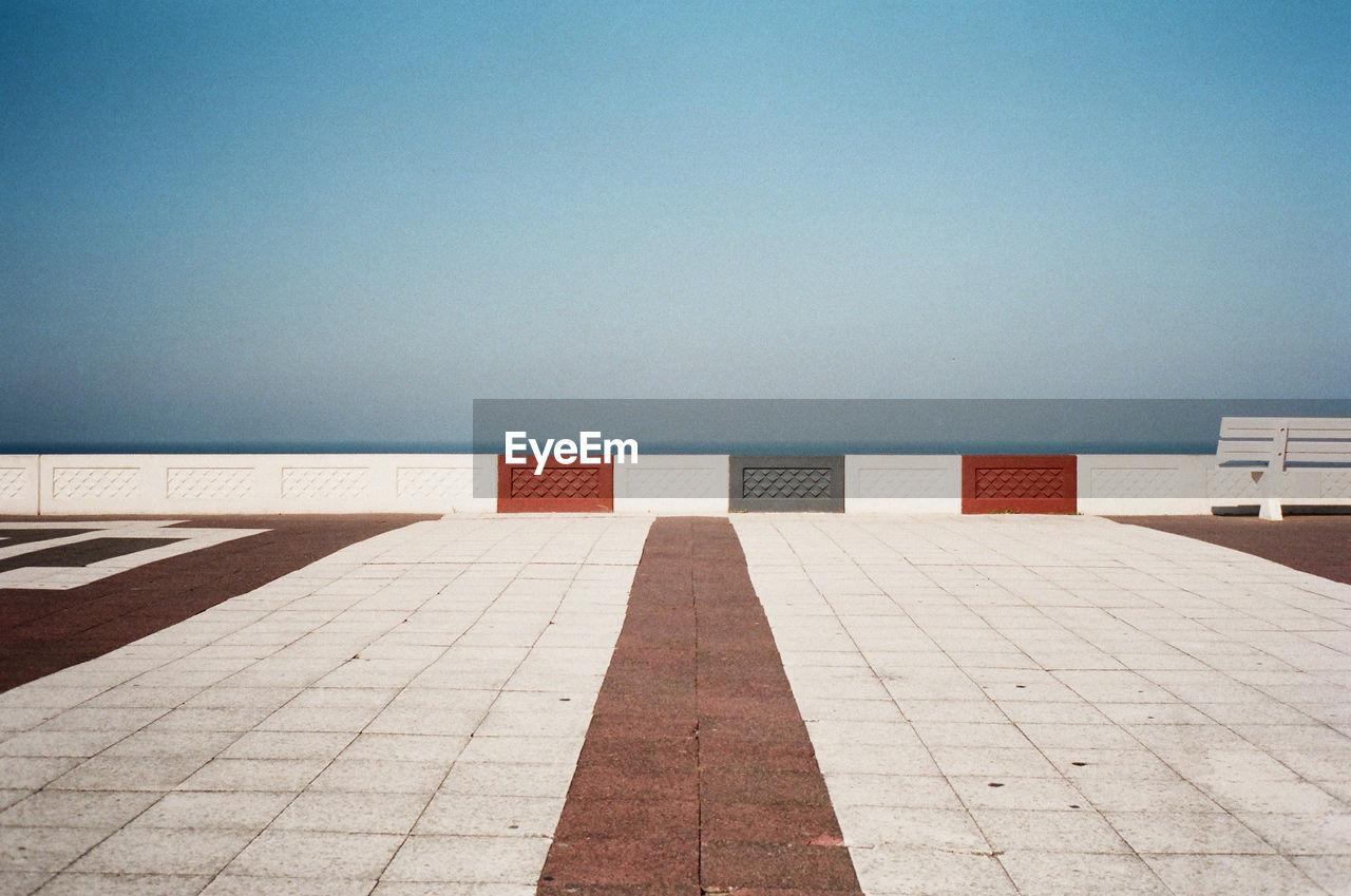 Promenade Against Clear Sky