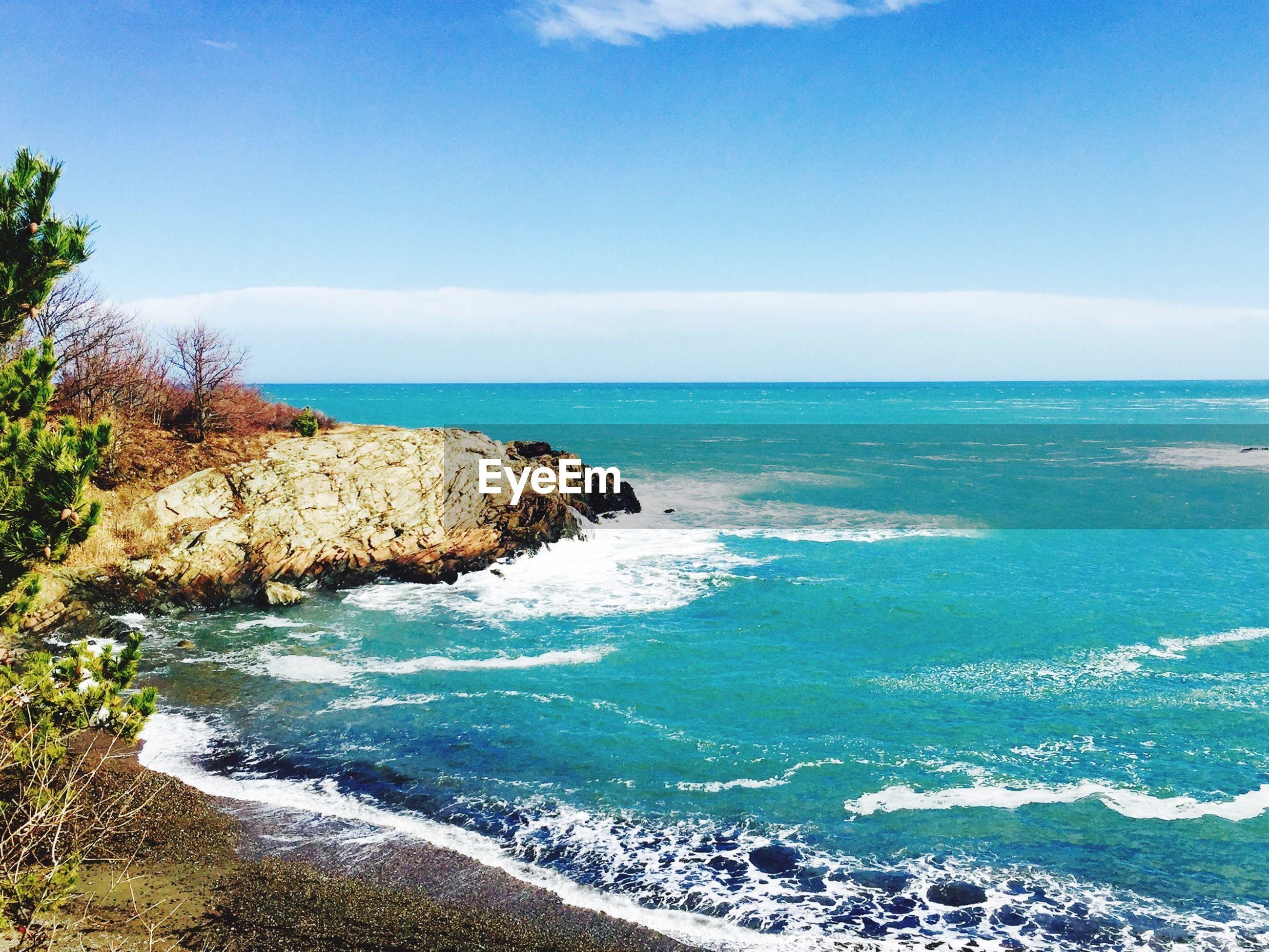 sea, water, horizon over water, tranquil scene, scenics, tranquility, beauty in nature, beach, sky, nature, blue, shore, rock formation, rock - object, sand, coastline, cliff, idyllic, rock, non-urban scene