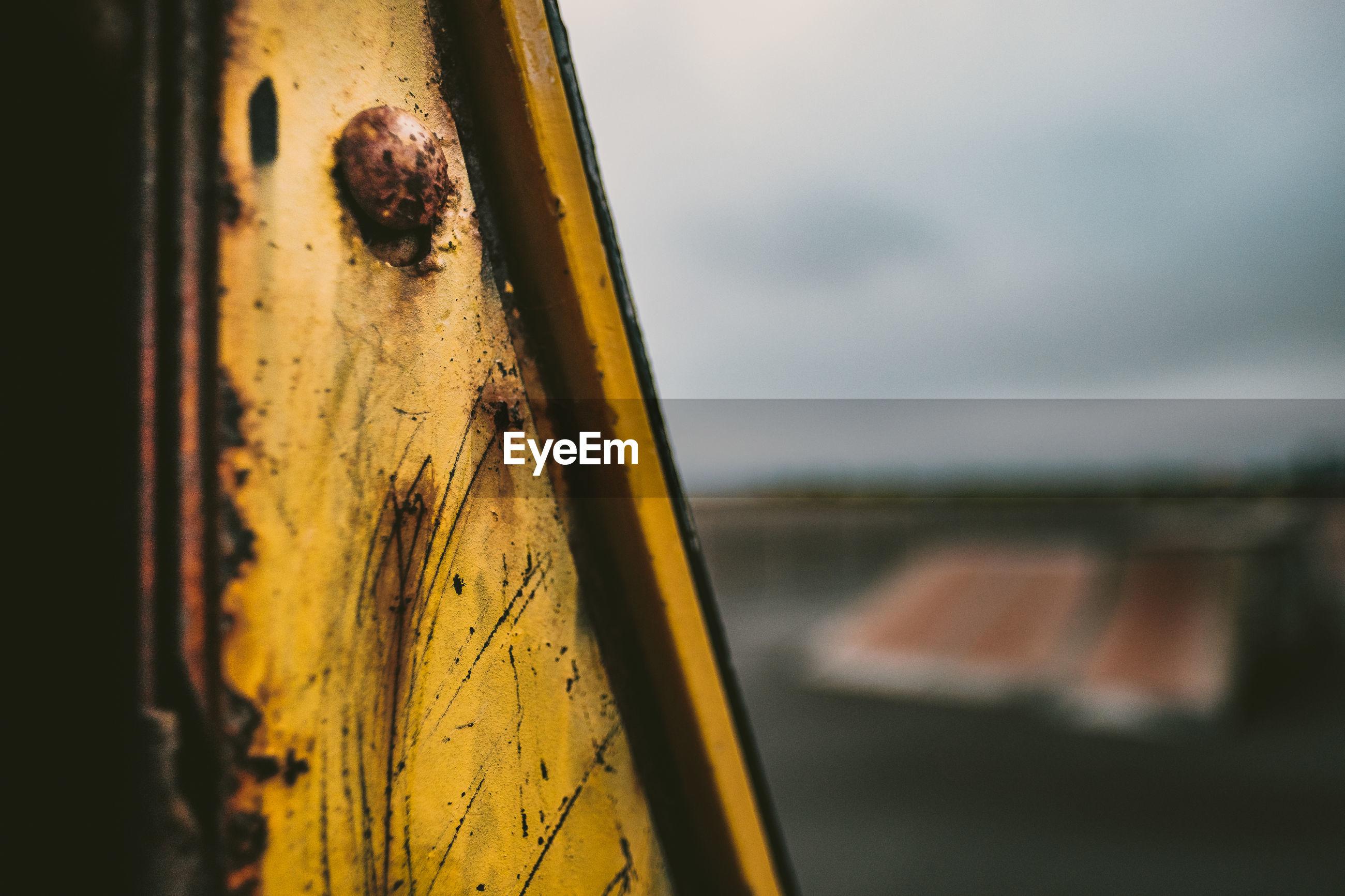 Close-up of yellow rusty metal