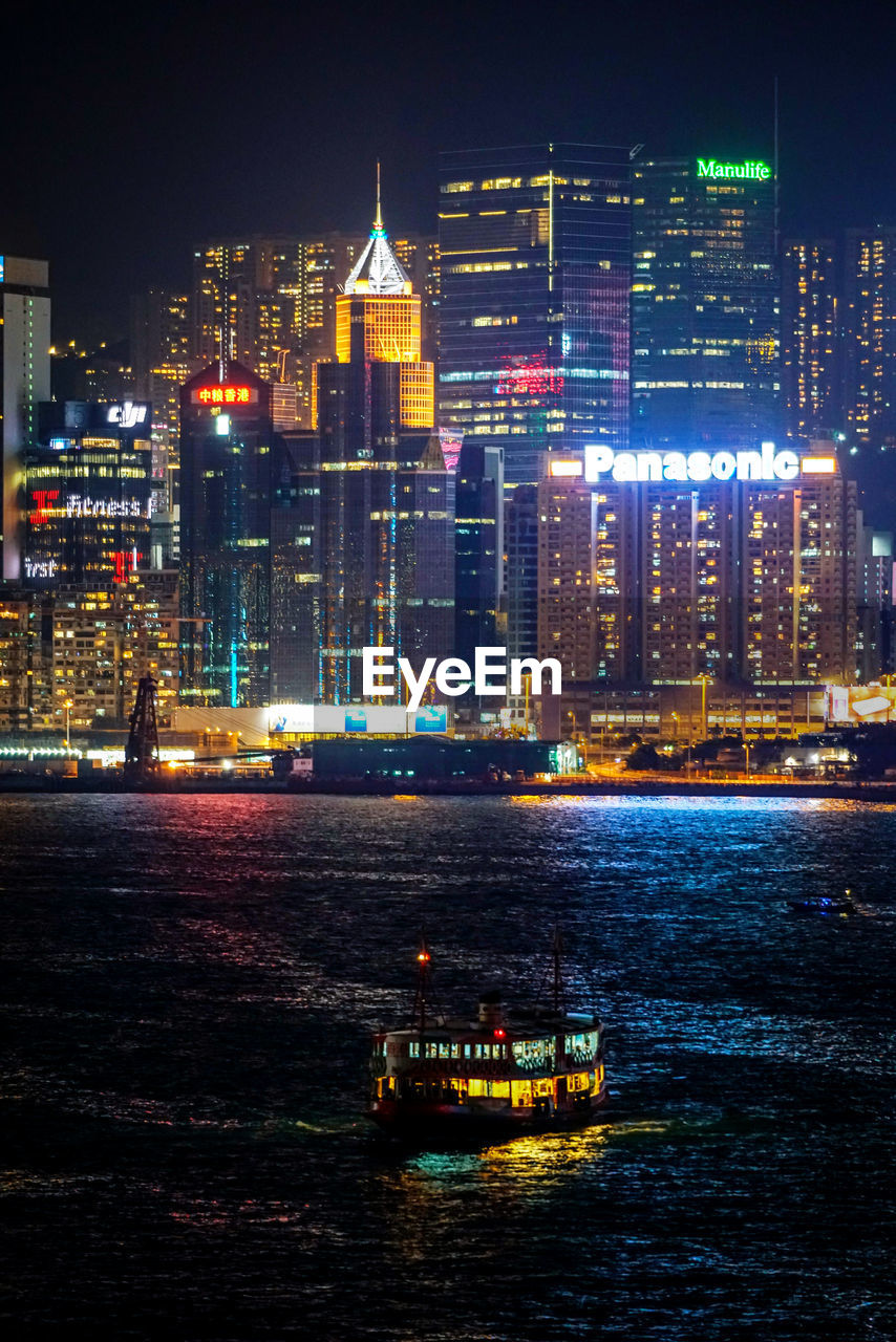 building exterior, built structure, architecture, illuminated, city, nautical vessel, night, water, waterfront, building, transportation, cityscape, office building exterior, mode of transportation, no people, landscape, nature, skyscraper, modern, tall - high, outdoors, financial district, passenger craft