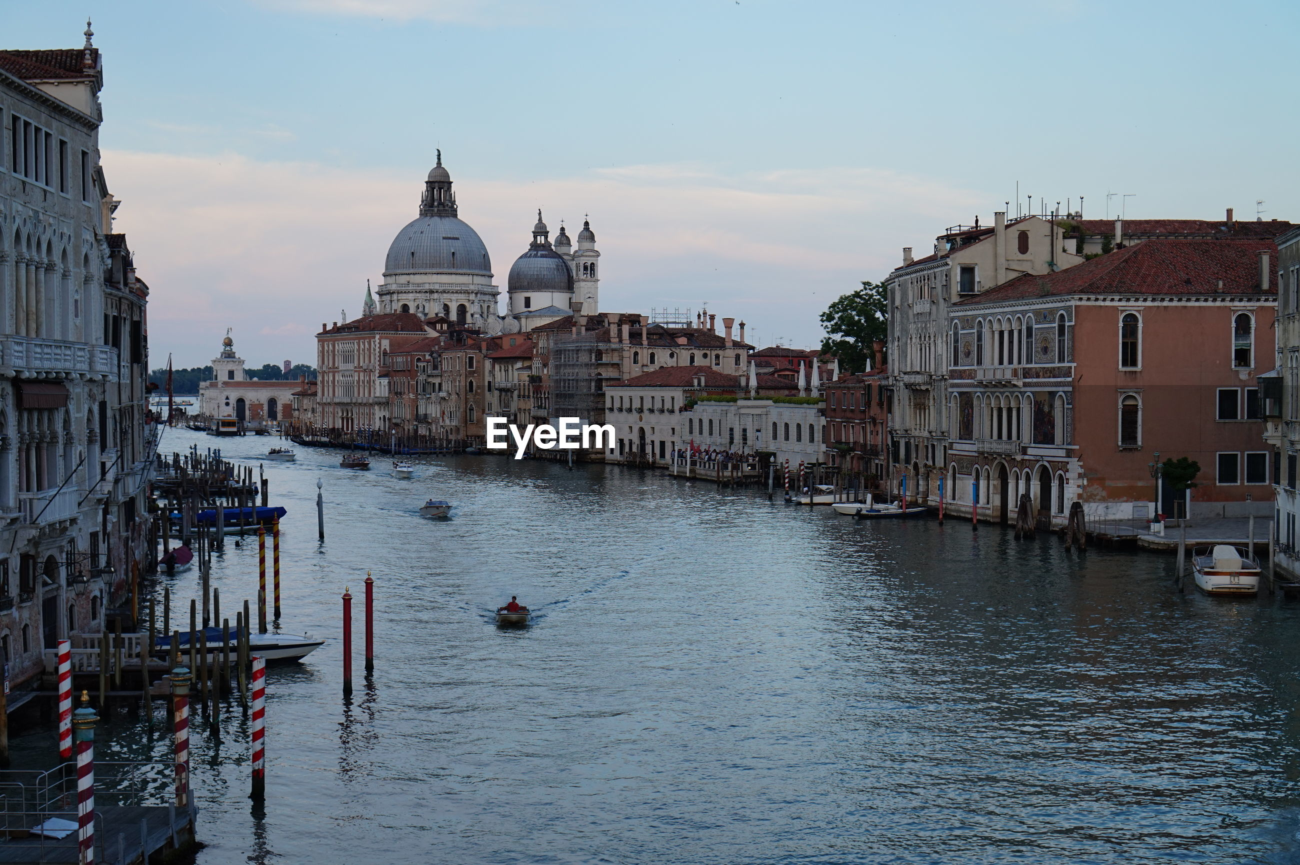 Santa maria della salute by grand canal against sky during sunset