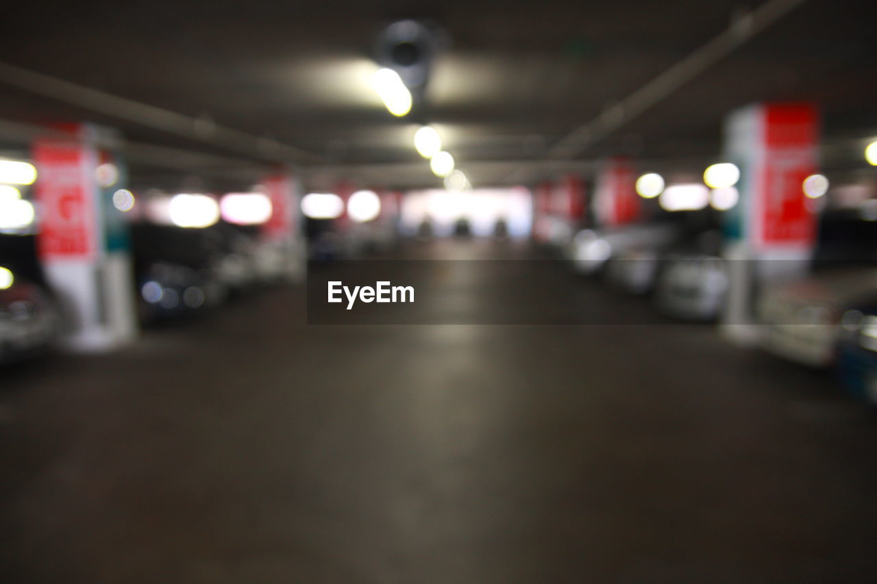 illuminated, lighting equipment, in a row, transportation, night, the way forward, mode of transport, land vehicle, indoors, no people, parking garage