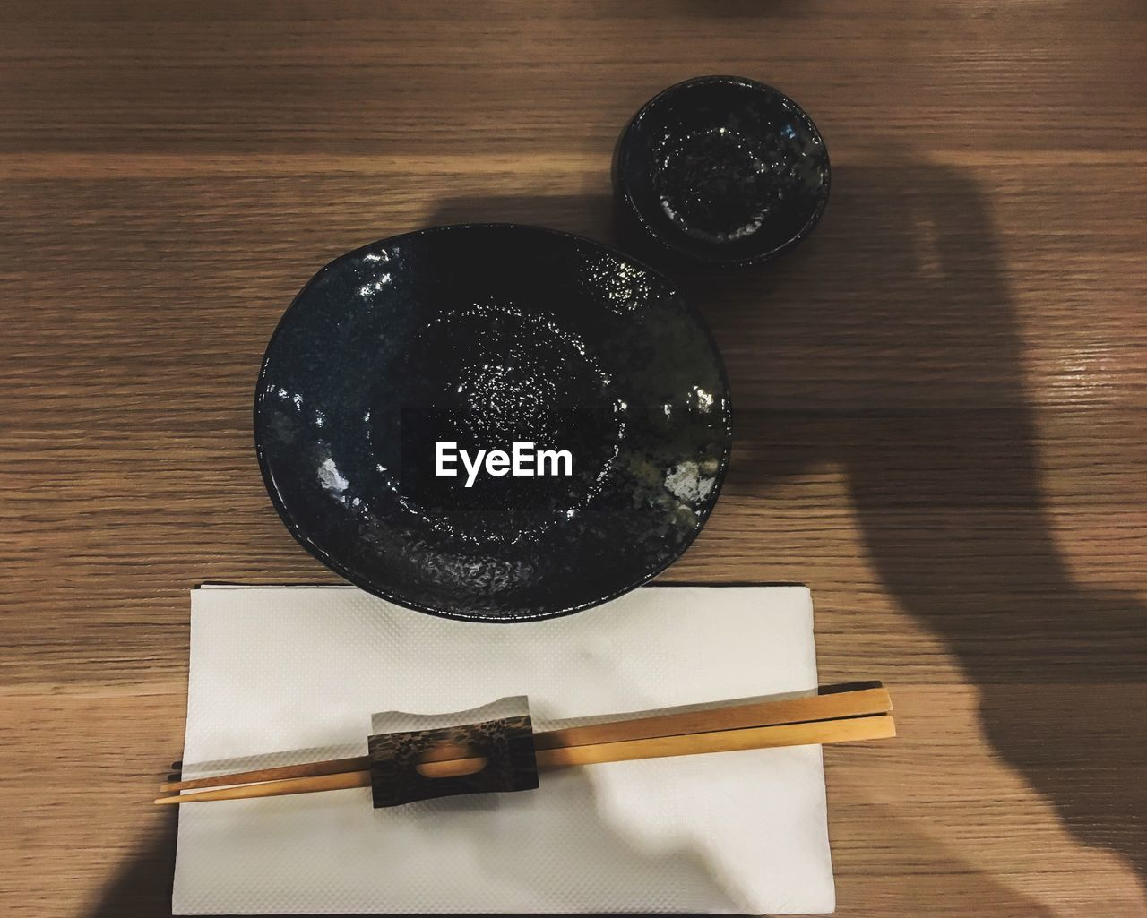table, wood - material, still life, indoors, high angle view, no people, directly above, wood, black color, shadow, food and drink, food, close-up, wellbeing, group of objects, container, freshness, hardwood floor, indulgence, chopsticks, japanese food