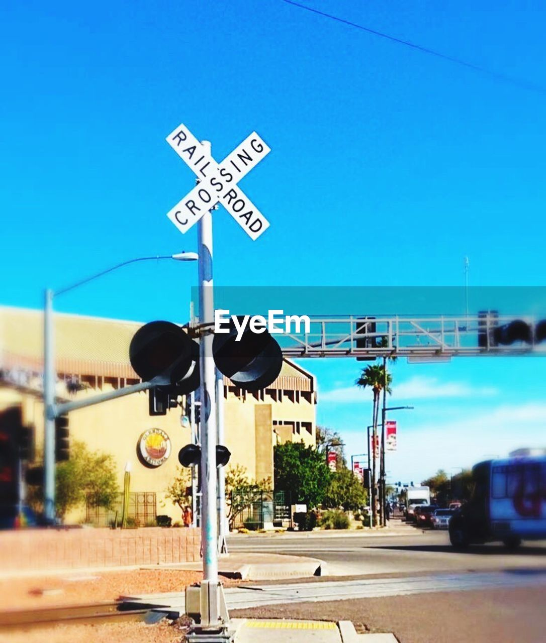 guidance, railroad crossing, crossing sign, road sign, transportation, railway signal, communication, blue, sky, day, outdoors, clear sky, one way, no people