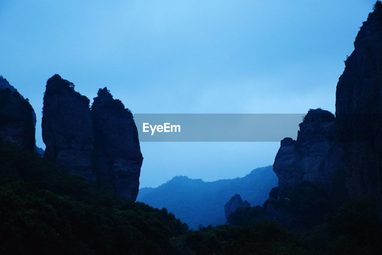 nature, beauty in nature, mountain, tranquility, cliff, no people, scenics, peak, outdoors, sky, day