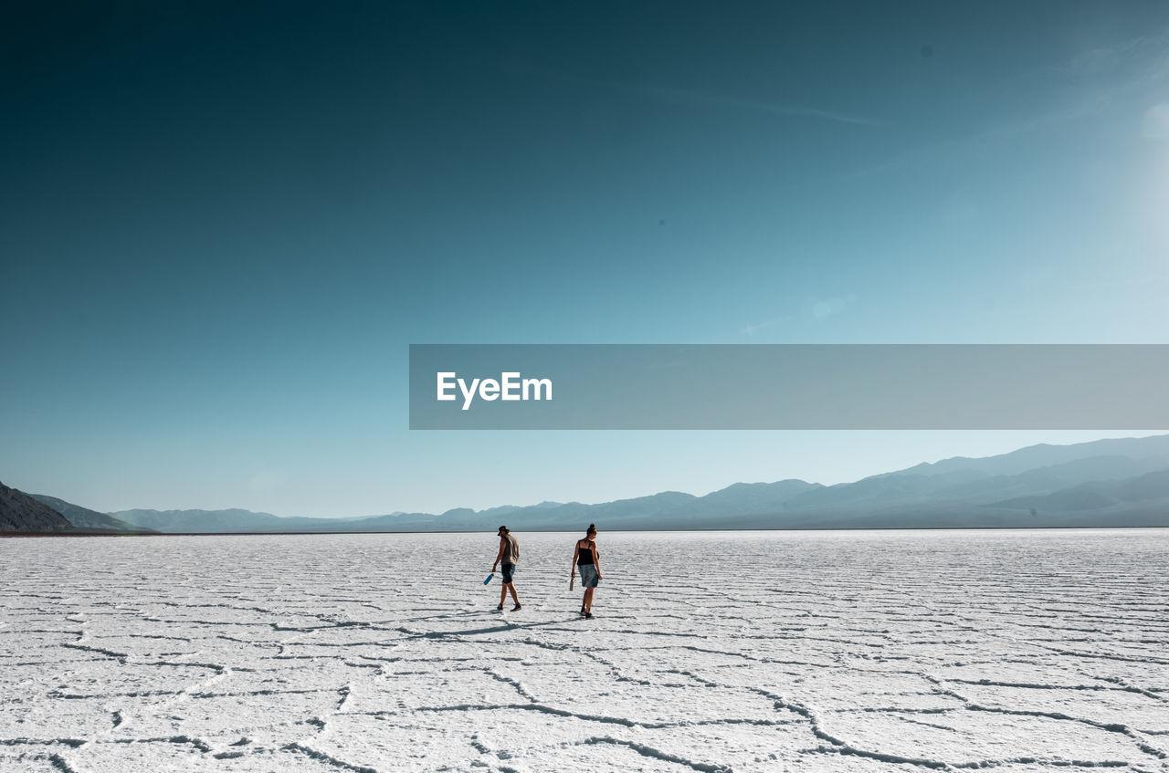 People standing on salt flat