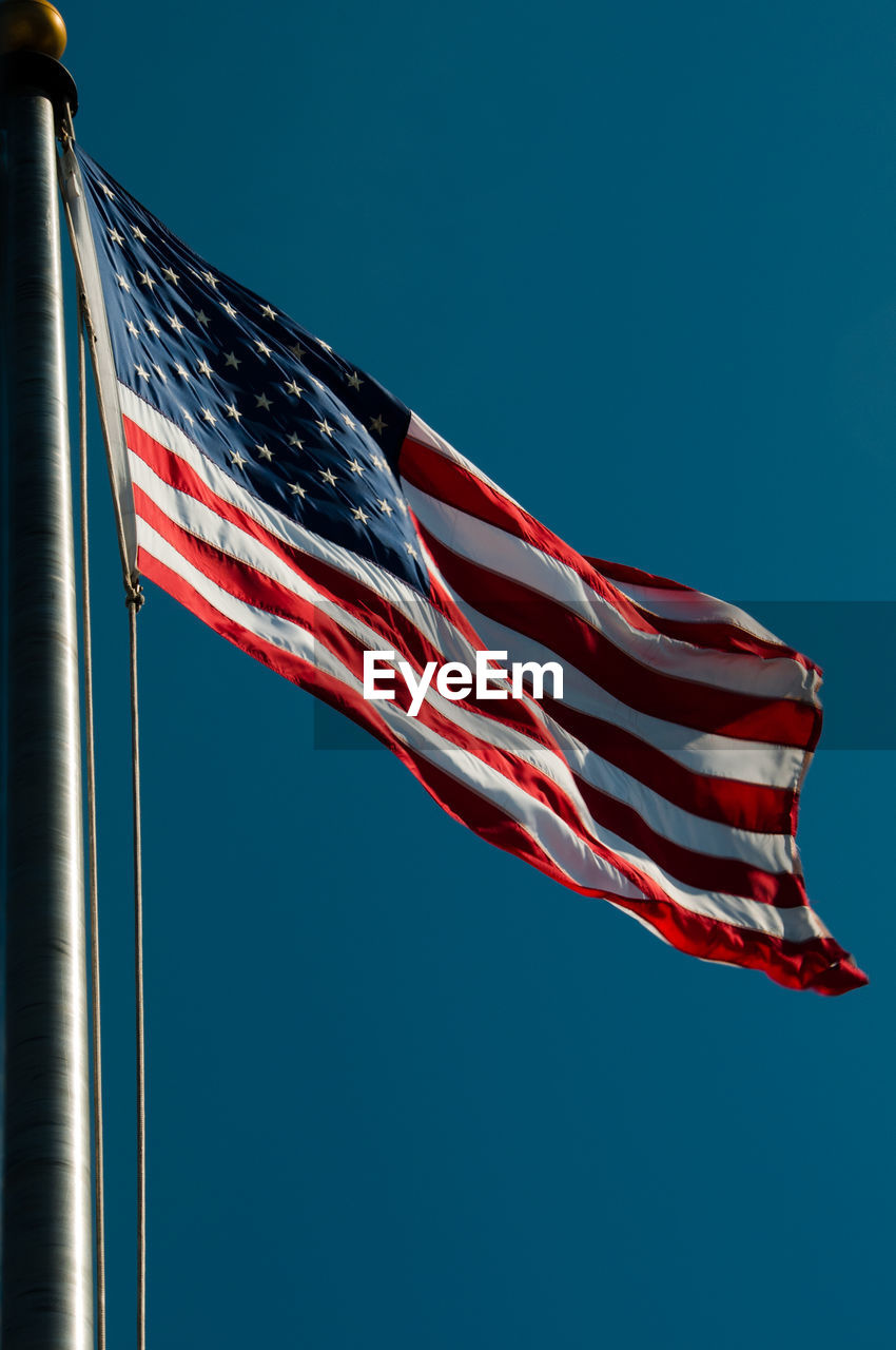 Close-Up Of American Flag Against Clear Sky