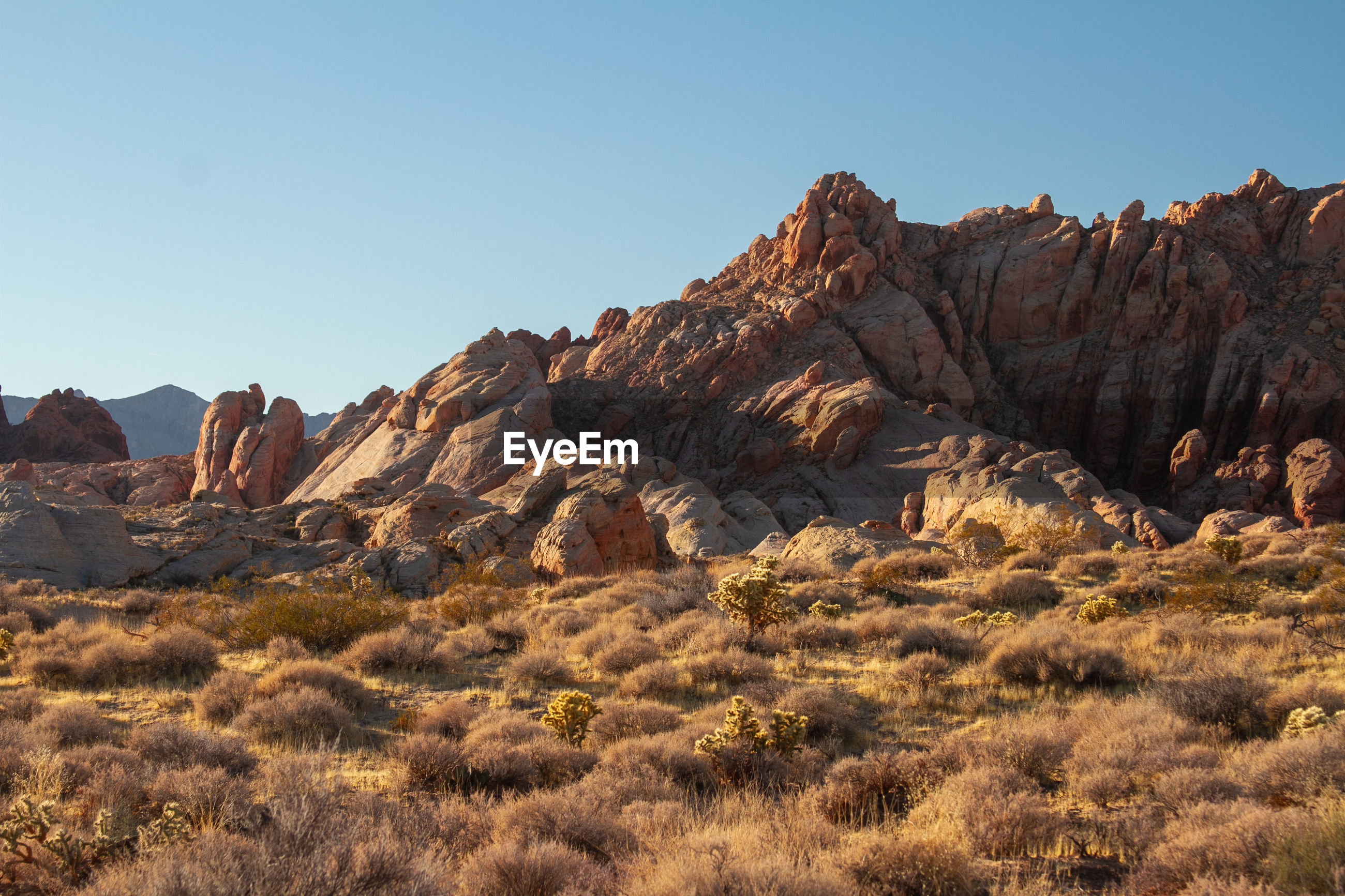 Rock formations on landscape against clear sky