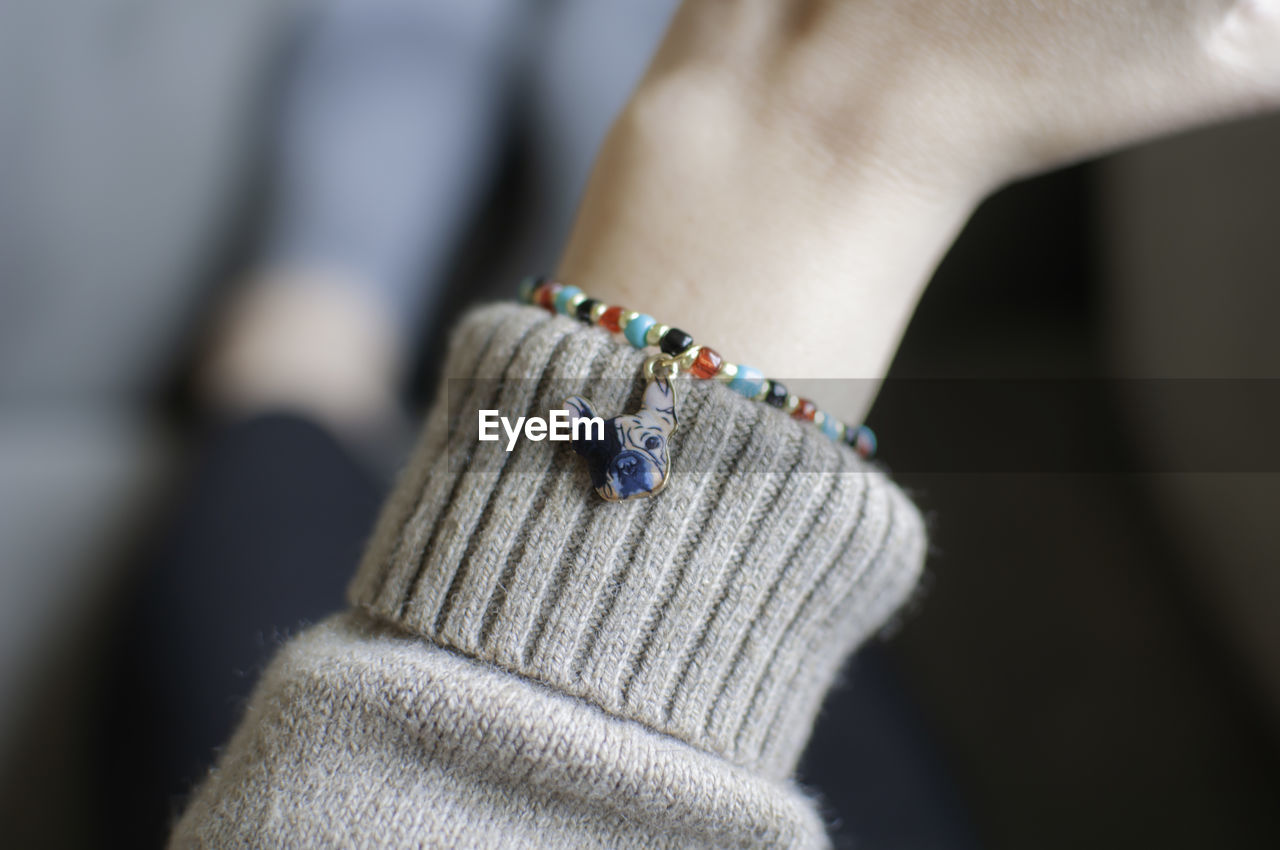 Close-up of woman hand wearing bracelet
