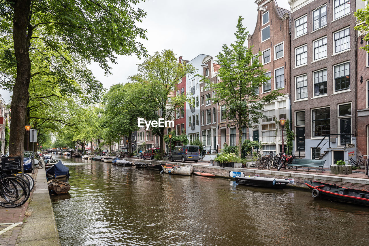 Canal by buildings in city