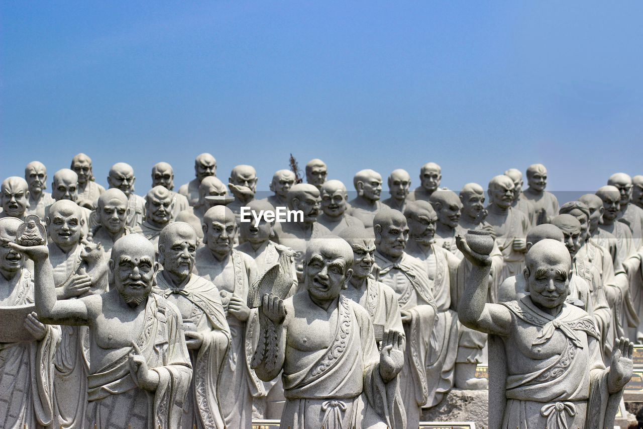 human representation, art and craft, sculpture, statue, male likeness, creativity, day, no people, outdoors, clear sky