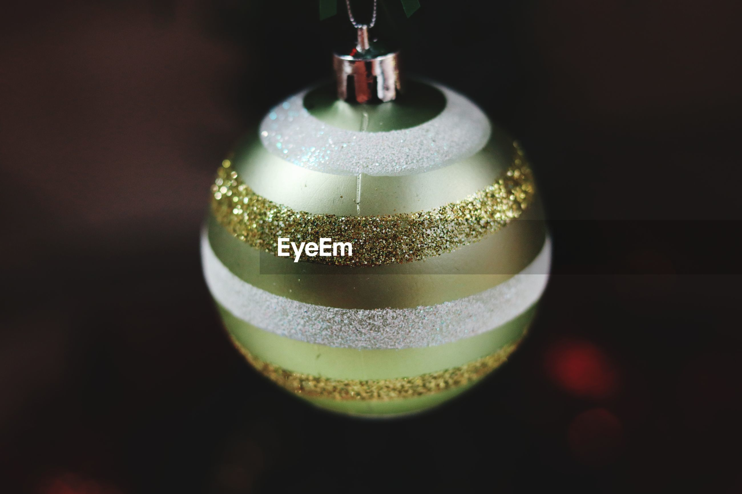 Close-up of christmas bauble against black background