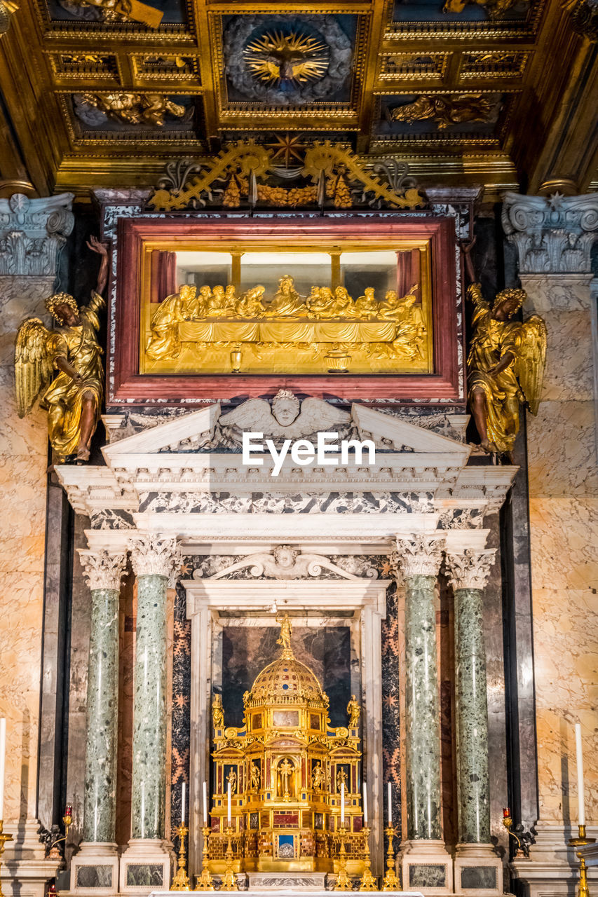 architecture, built structure, travel destinations, place of worship, religion, building exterior, belief, building, art and craft, gold colored, low angle view, spirituality, sculpture, human representation, statue, representation, city, history, the past, craft, no people, architectural column, ornate, altar, ceiling, carving