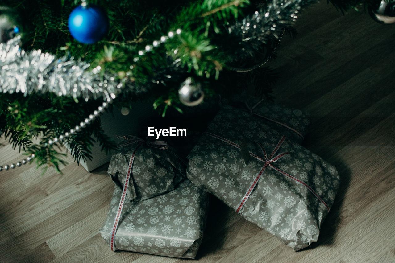 High Angle View Of Christmas Tree And Gifts On Floor