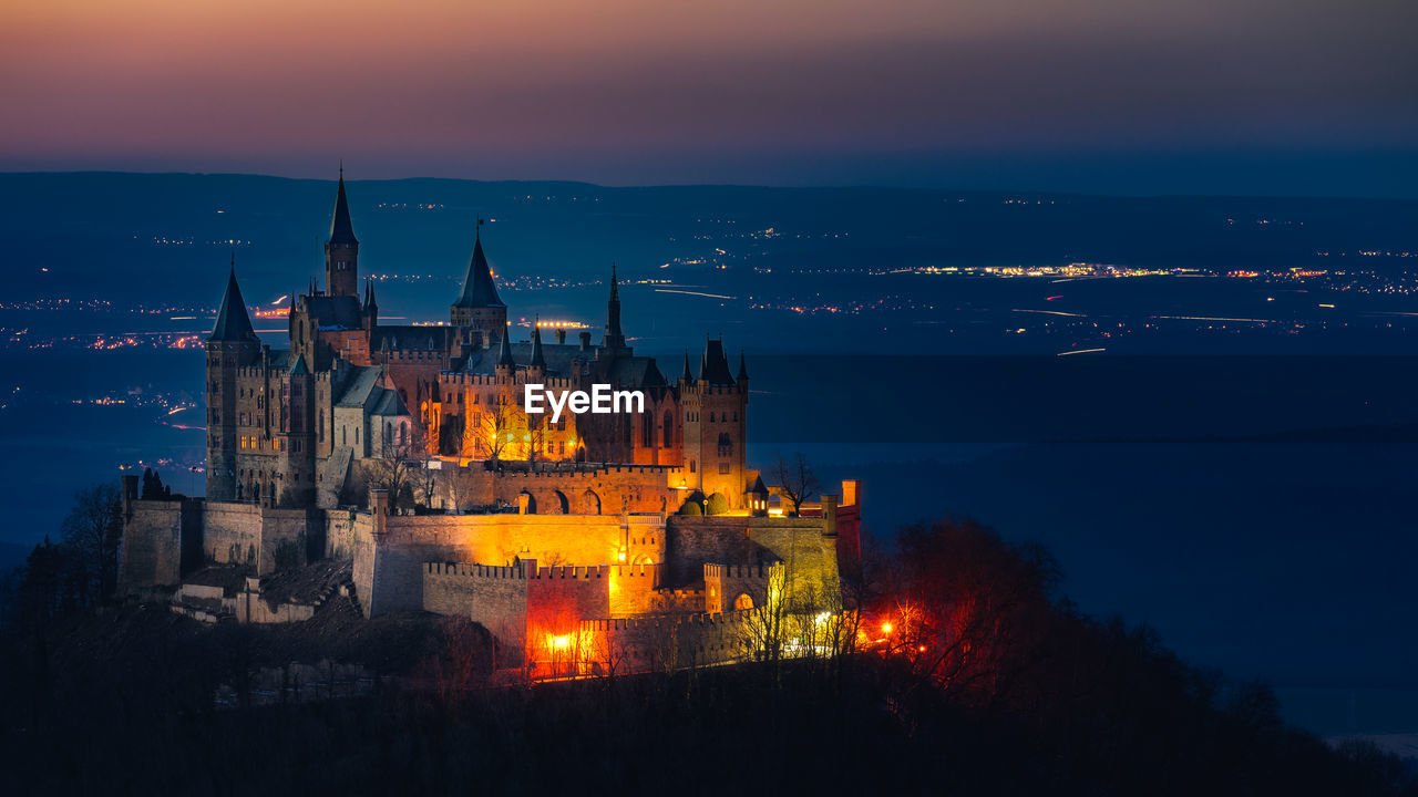 architecture, building exterior, built structure, history, place of worship, spirituality, religion, illuminated, night, sunset, travel destinations, sky, no people, dusk, outdoors, castle, cityscape, nature, city