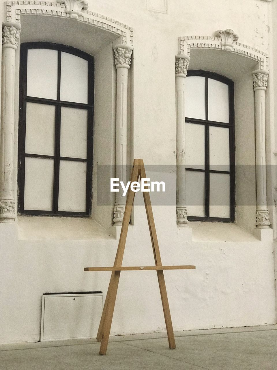 architecture, built structure, window, building exterior, building, no people, day, wall - building feature, door, wall, closed, entrance, wood - material, house, absence, residential district, white color, outdoors, empty, low angle view, ladder